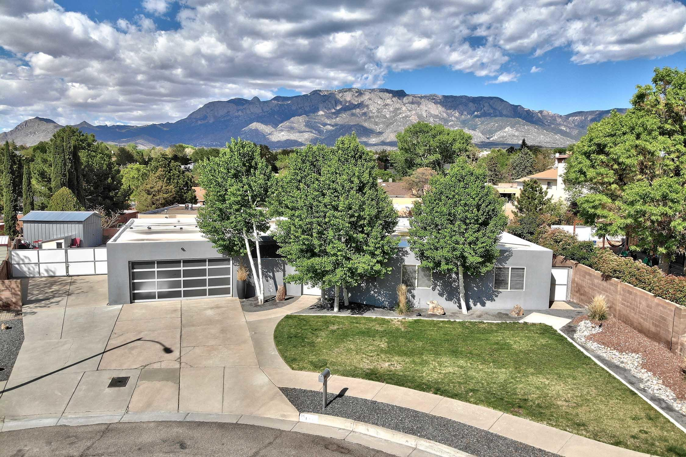Recently remodeled home located in the highly sought-after Academy Hills neighborhood. A beautiful, private courtyard welcomes you into a modern home full of natural sunlight. The updates that were made to this home were tastefully done throughout and executed to perfection. The tile flooring is complemented nicely by the smooth textured walls & ceilings, plus new wall plates, sockets and switches provide a clean, modern look. The kitchen is open to the dining room, and the two living areas, and is loaded with modern conveniences that are sure to make cooking in it a joy. A stainless steel refrigerator and electric range are surrounded by plenty of cabinets. Plus, there is a walk-in pantry with room for food storage and for all