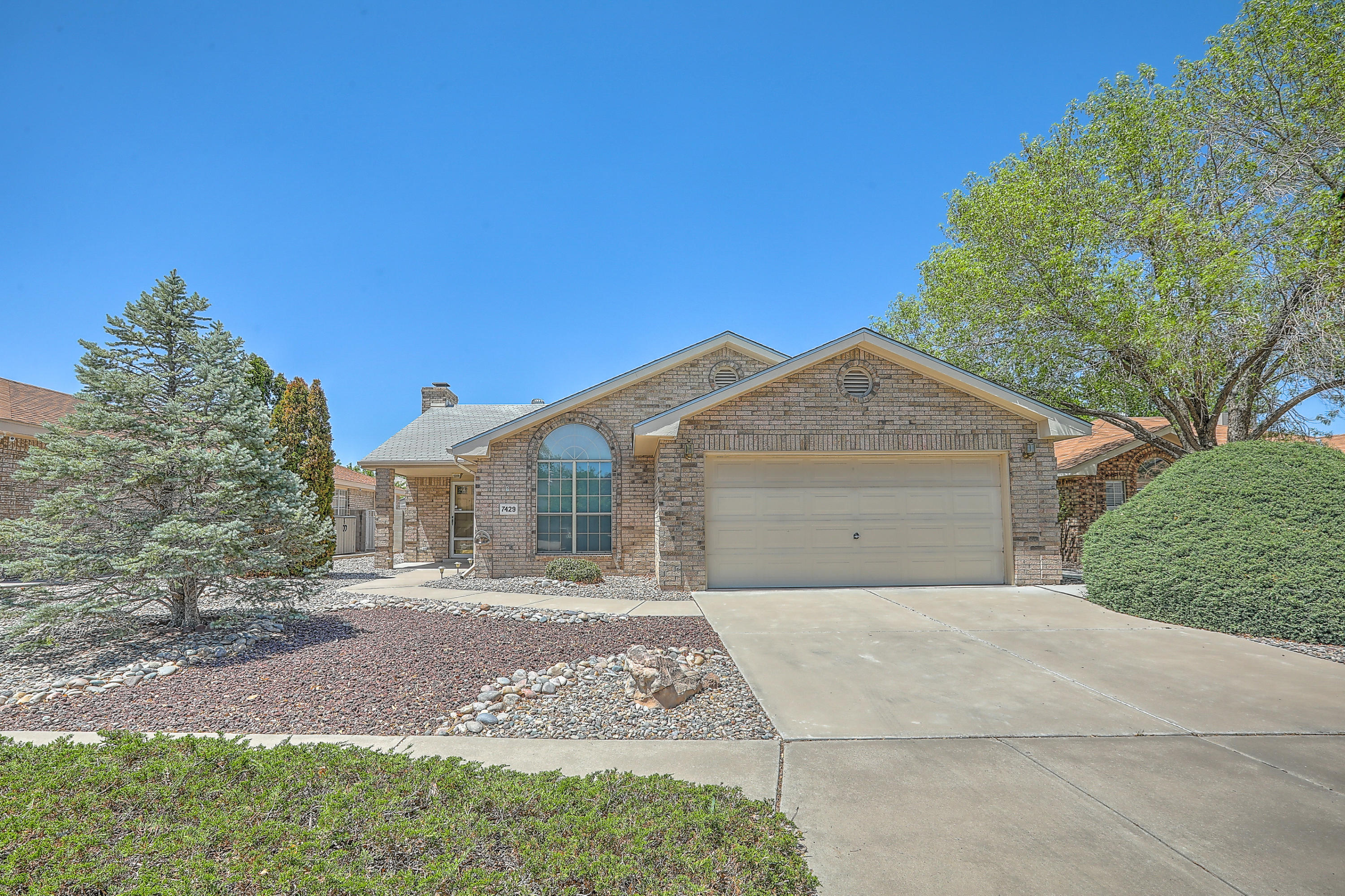 Beautiful Opal Jenkins Brick Veneer home located in Taylor Ranch. Home features - Large great room with fireplace, spacious - open and bright kitchen, Master bedroom plus 2 additional bedrooms, covered patio and refrigerated A/C!
