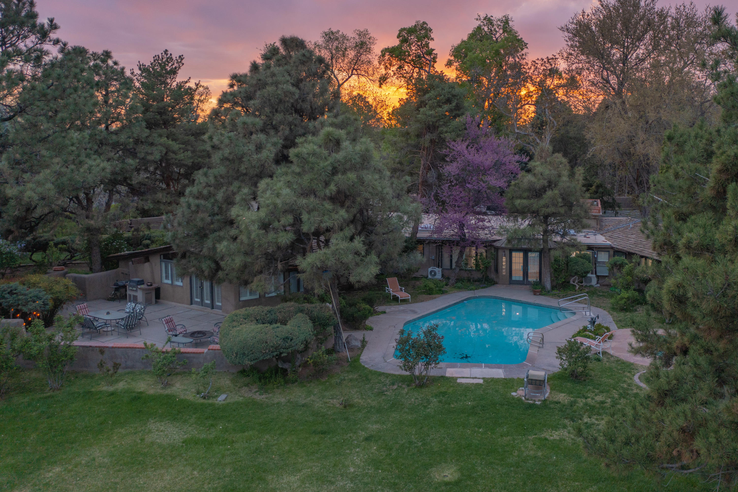 Stunning Nat Kaplan Adobe beauty tucked away on a private 2.31 acre gate property located in the coveted North Valley community. Home features 4,773sf with 4 bedrooms, 4 bathrooms, multiple living areas, a 909sf casita and a pool! Original brick floors, adobe walls and Nat Kaplan beamed ceilings line the halls of this home. Beautiful main living with adobe charm, hand crafted beamed ceilings and wood burning fireplace. Kitchen with custom cabinetry, tile countertops and more! Spacious owners suite with a vaulted beamed ceiling, outside access to the pool and private bath. Take advantage of the home office also perfect when home schooling! 900sf casita w/ a living area, kitchen, bath & bedroom! Mature landscape maintains your privacy when you take a dip in the pool or dine in the courtyard!