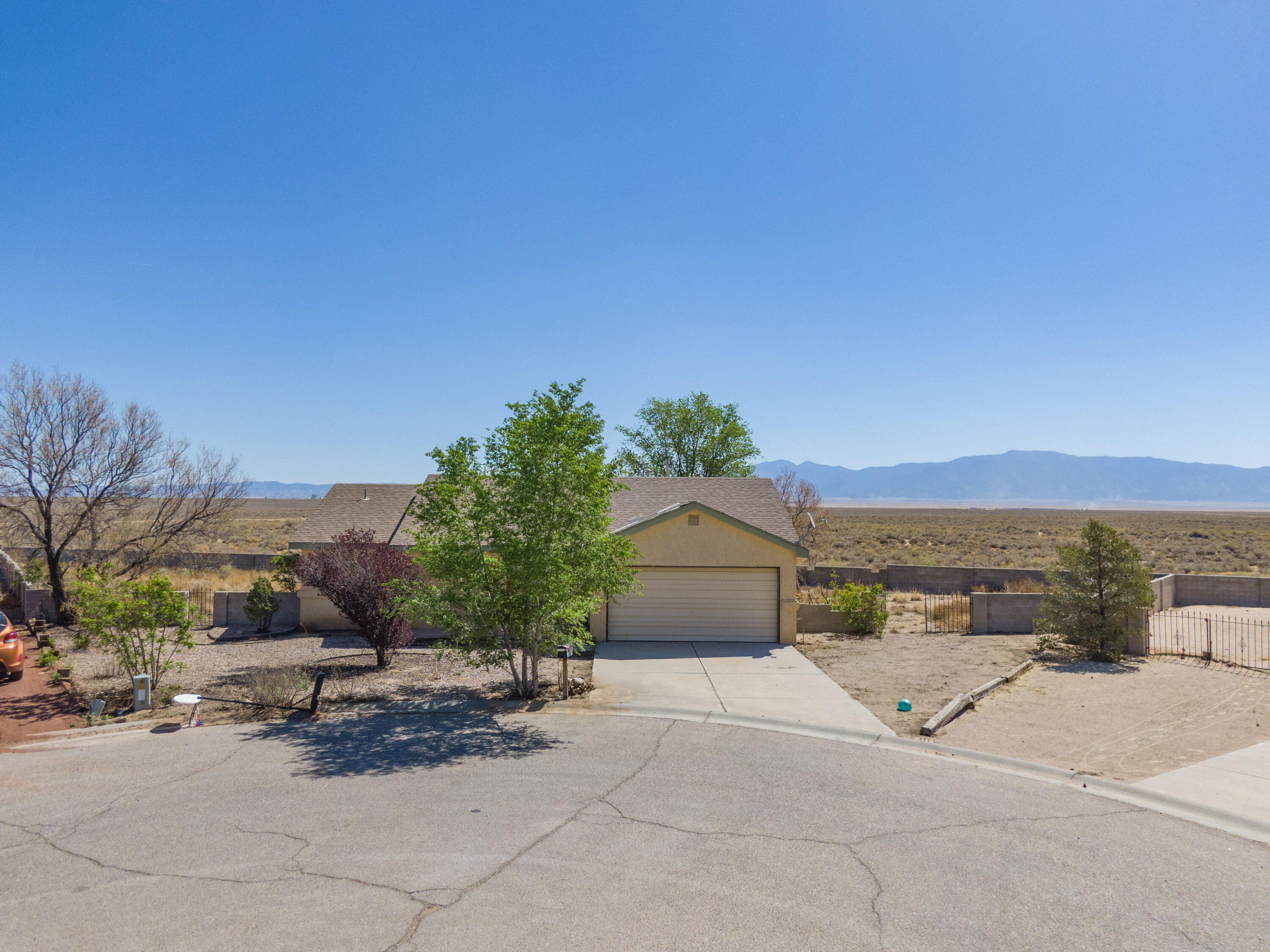 CASH ONLY. Welcome to this 3 Bedroom, 2 Bath, 2-Car Garage, Single-Story Home in Los Lunas! Situated on a Quiet Cul-de-sac on a Large .38-Acre Lot with *Stunning, Panoramic, Unobstructed Views of the Manzano Mountains*, 21 Hermanos Court presents you with a Rare and Promising Investment Opportunity. Fix & Flip, or, Bring Your Paintbrush + Imagination to Customize this Home as you wish. Home to be sold as-is, where is, with all faults. CASH ONLY.