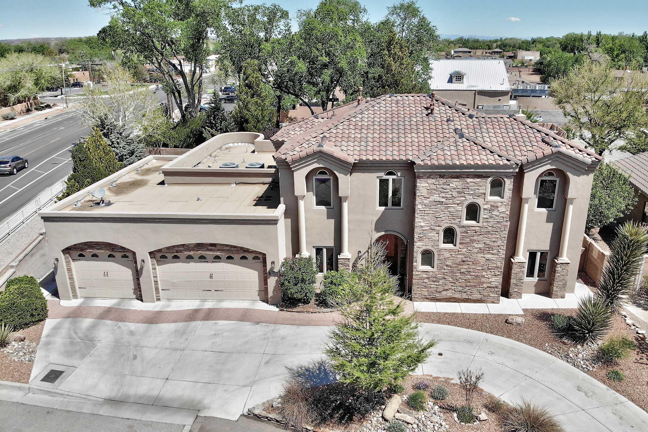 Beautiful, custom-built Tuscan style home in a private Cul de Sac neighborhood in the North Valley. This home has a wonderful rustic design aesthetic and features incredible details throughout the home, including travertine tile flooring, an open floor plan, tons of natural light and a gas fireplace in the living room. The fully-equipped chef's kitchen features alder cabinets, granite countertops, an island with room for seating and commercial KitchenAid Stainless Steel appliances, including double gas ranges and pot filler. The spacious butler's pantry and laundry room provides plenty of useful storage space. The wet bar is absolutely perfect for entertaining, and the formal dining room promises to bring plenty of elegance and class to all of your social gatherings. Natural light from sun