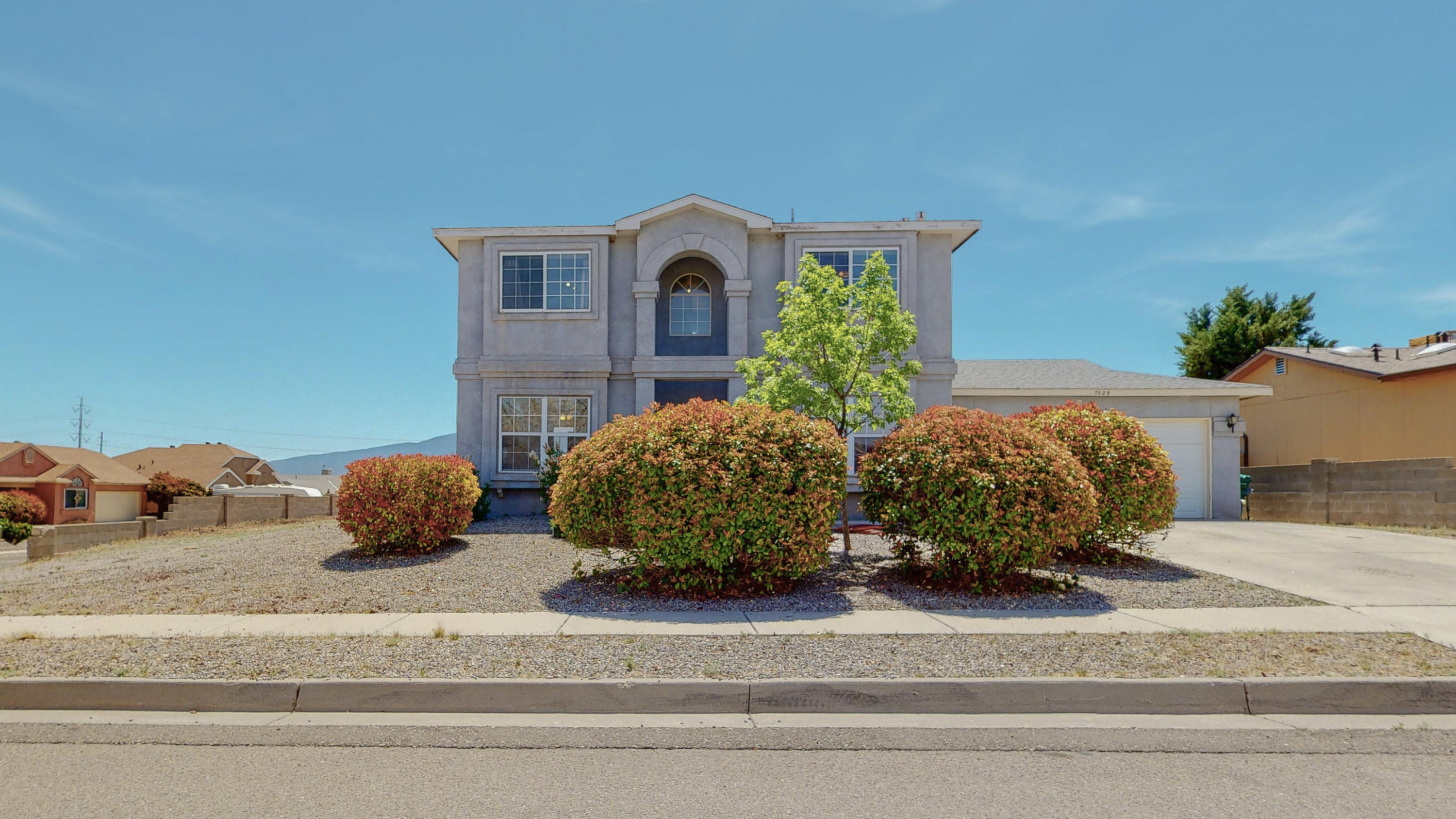 Come enjoy the beautiful view of the Sandia Mountains from the backyard of this two story three bedroom, three bathroom home. It has tile downstairs and brand new carpet upstairs. With refrigerated air and easy access into Albuquerque this home is ready for you!