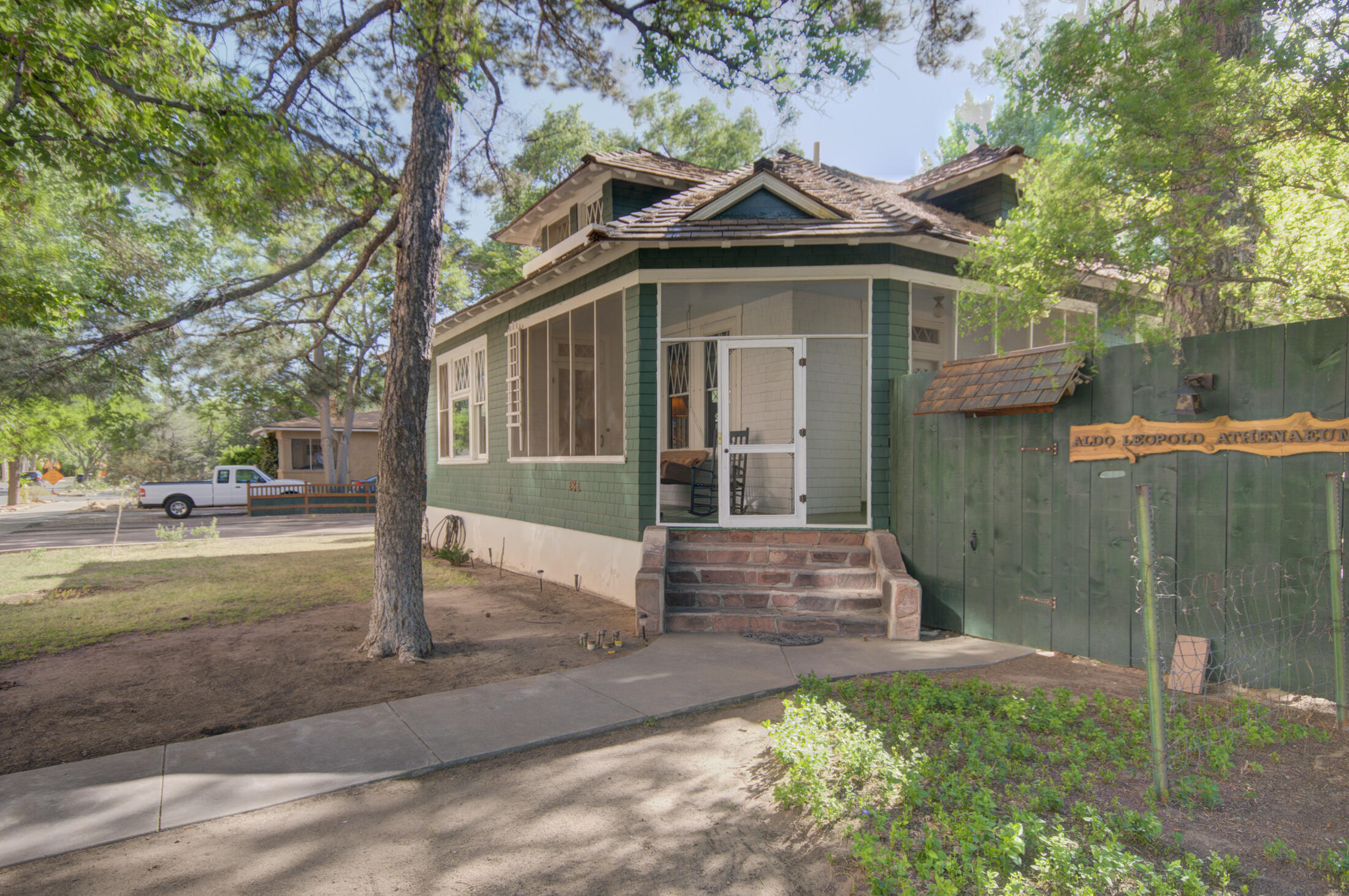 Stunning and one of a kind! Rare opportunity for a craftsman bungalow in historic Huning Castle neighborhood. Spacious, charming courtyard; includes 2-- 450 sq. ft. studios for INCOME GENERATING opportunity! Backyard  includes 250 sq. ft. workshop space with backyard access. Registered as part of the Aldo Leopard historic district. Gorgeous home includes original wood work, diamond paned windows, built-in buffet and bookcases. Coffered ceiling crowns the living room with striking flagstone fireplace. Douglas fir red cedar shingle roof completed in 2011 and oiled in 2019. Space to spread out!  Wonderful neighborhood! Pergolas, trees, native plants offer serenity in the midst of city life.Walk to bosque,biking  trails, downtown,Old Town,EZ access Facebook, Netflix. A gem, & OWNER FINANCING!