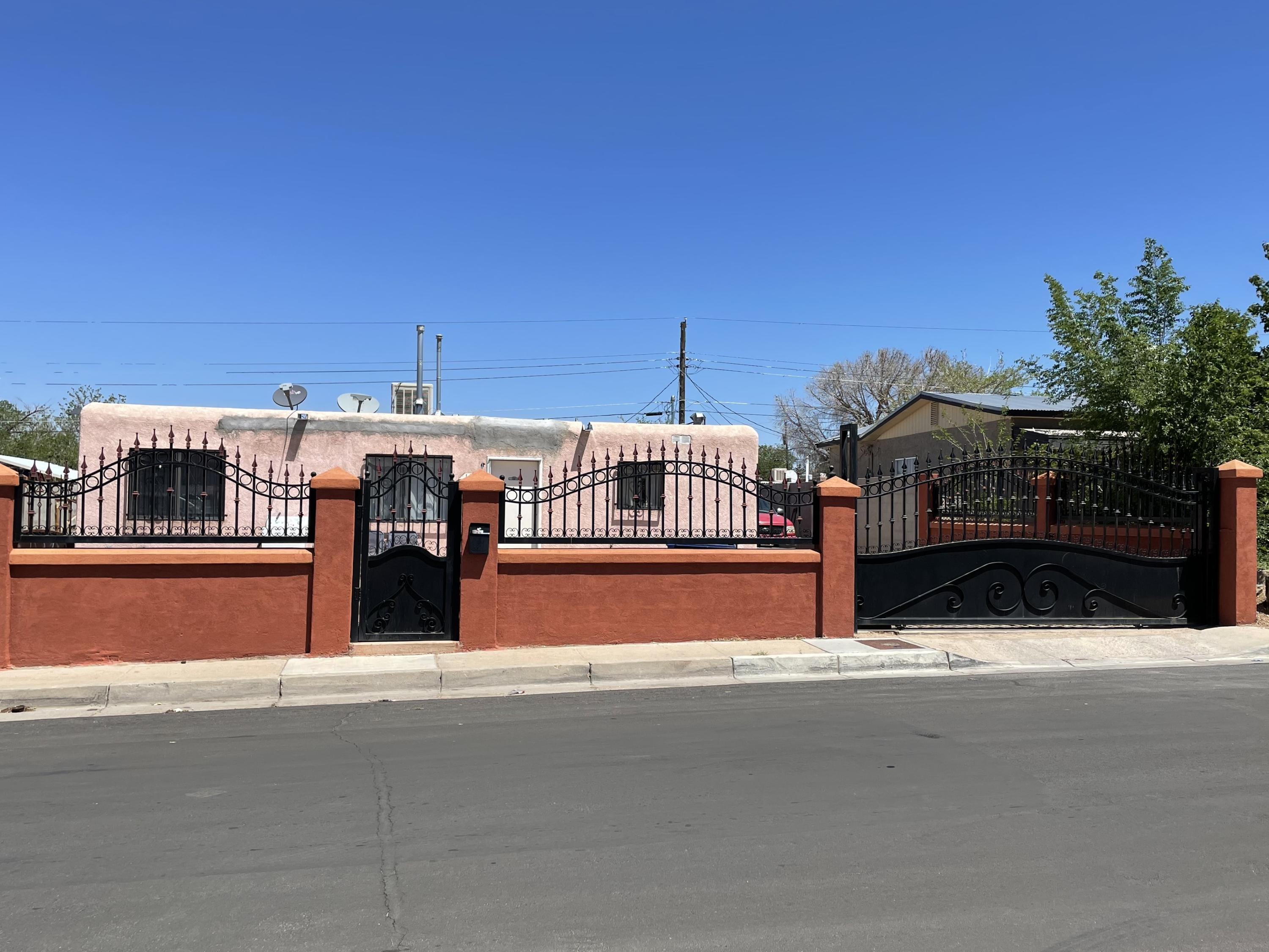 Large Lot, with access,  Block wall all around and pretty worought Iron work in the front.Near shopping and restaurants and schools.