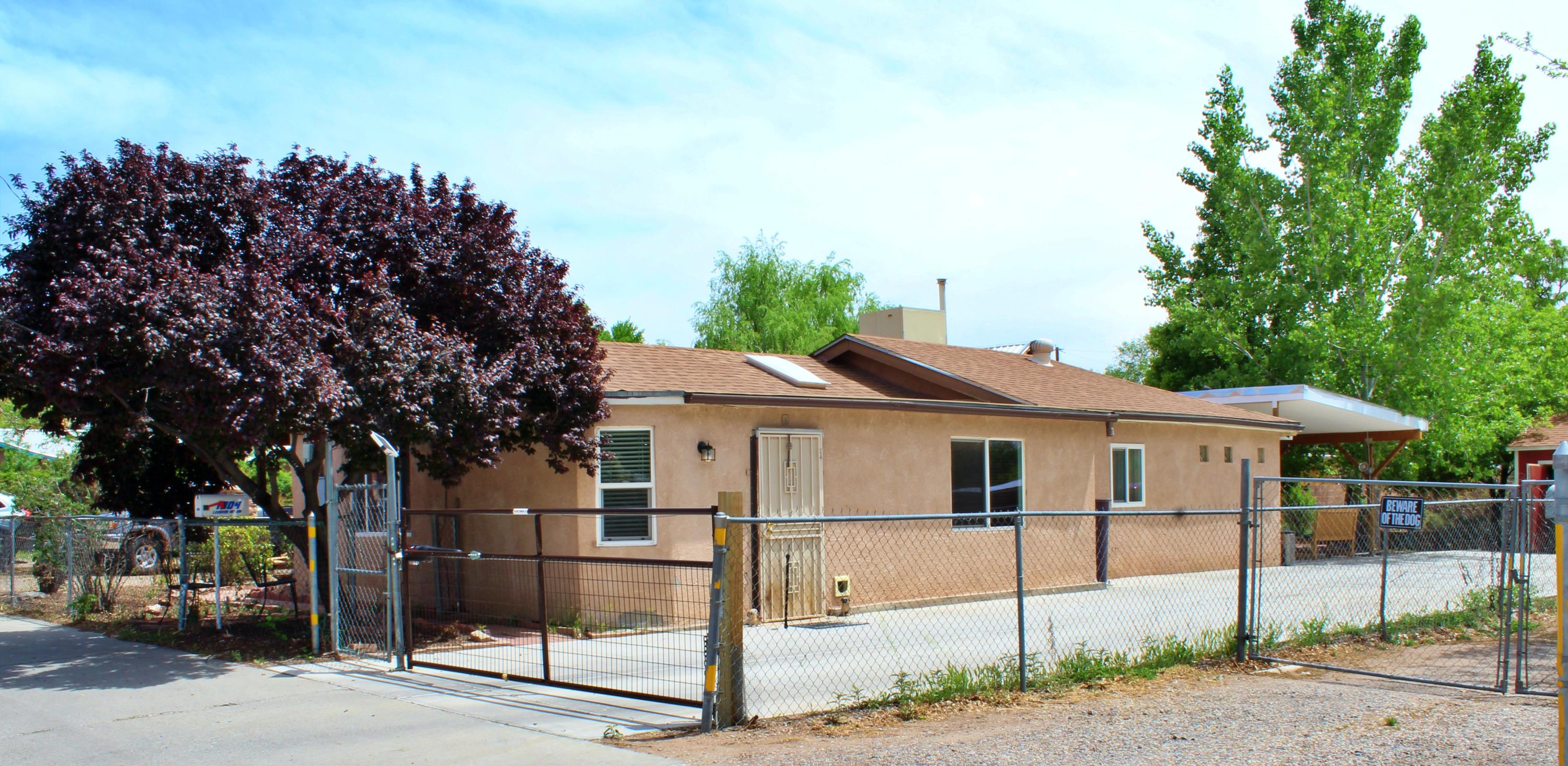 Please view this Amazing home in the heart of Albuquerque. This home is located in a quaint neighborhood close to many local attractions. This home Features Updated Laminate Flooring and Ceiling Fans. Includes Smart Electric Gate, and a Smart Front Door Lock. Attached is also a very large back yard full of vegetation, a small pond, a large shed, swing set, and a Hot Tub to enjoy the lovely Albuquerque nights.
