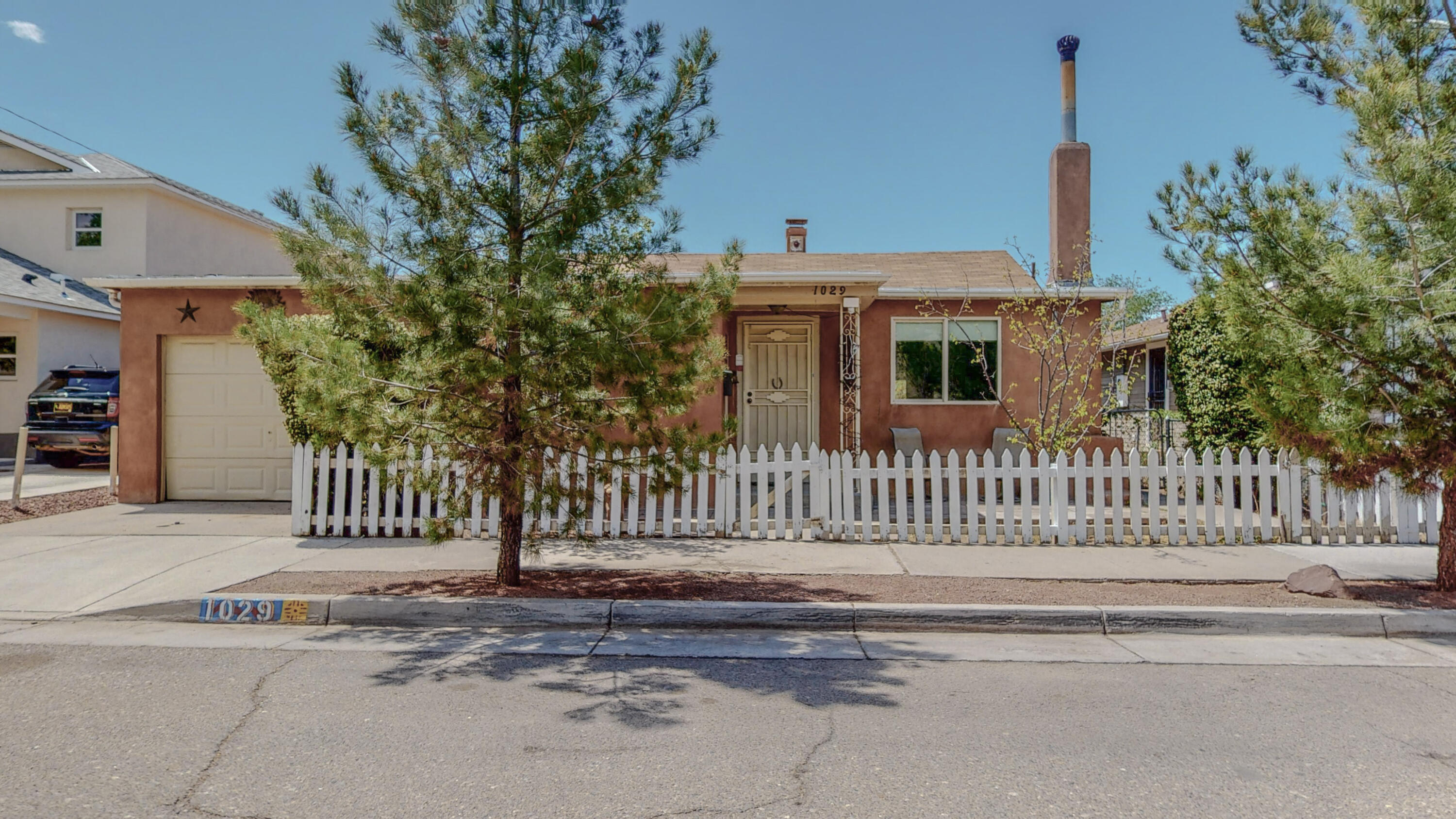 Downtown area adobe home, great location.  Some upgrades include ceiling fans,  new roof, new windows and tiled flooring in  large livingroom with kiva fireplace.   Great for entertaining in a big backyard with a built in grill and two adobe rooms for storage or art studio.  Also has backyard access for an boat and RV.  Sold as is, Seller is willing to give carpet allowance, Estate Sale KEY for Rod Iron Door Only.  Lock back and side please.