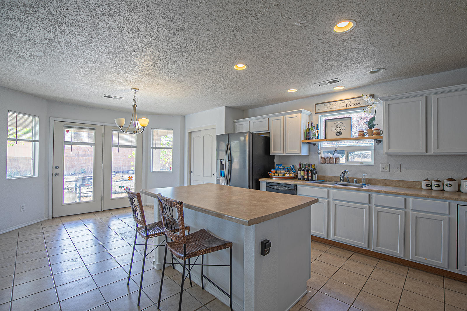 Take a look at this beautiful 3 bedroom 3 bath home! Complete with over 2,100 square feet, open floor plan with 2 living areas. This home has just been completed with new flooring throughout! Schedule your showing today this property won't last long!!