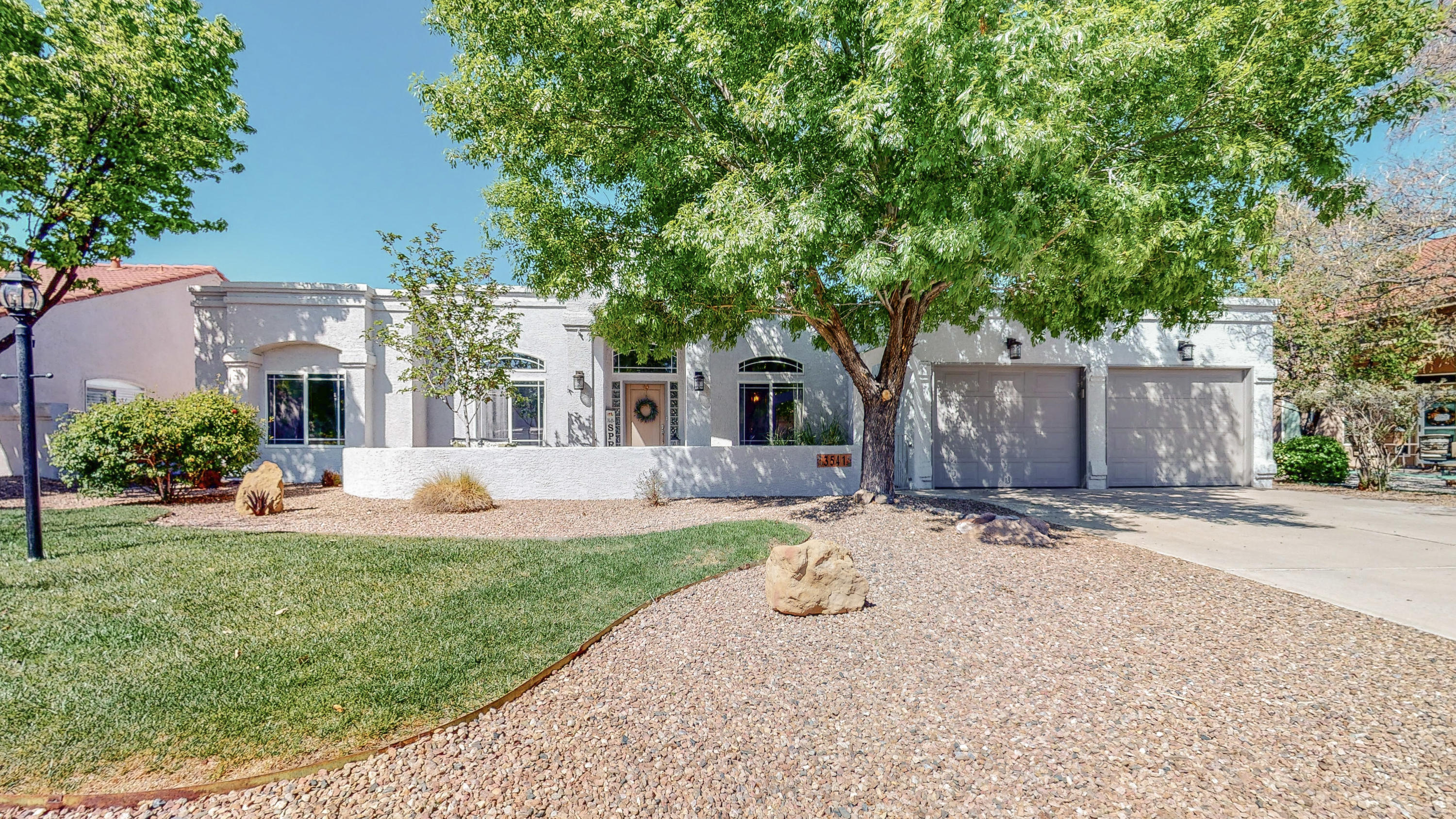 AHHHMAZING Completely Renovated Home Through Out. Located In Top Desirable Area With First Class Amenities! Tongue & Groove Ceiling With Beams And Corbels. Bright Open Gourmet Kitchen With Granite Counter Tops, Stainless Steel Appliances & Custom Cabinets. Beautiful Master Suite With Patio Access. Quartz Counter Tops In Bathrooms & Designer Tile.  Mini Master With En Suite. Gorgeous Bamboo Wood Flooring. Wood Look Ceramic Tile.  Venetian Plaster Kiva Gas Fireplace. Huge Storage Area In Garage With Cedar That Makes The Perfect Handy Man Workshop. Lavish Lush Front & Backyard Landscaping With Beautiful Mature Trees, Foliage & Raised Planters. Over Sized Lot On Most Sought After Street In Rio Rancho.  This House WILL IMPRESS & Is A MUST SEE!!