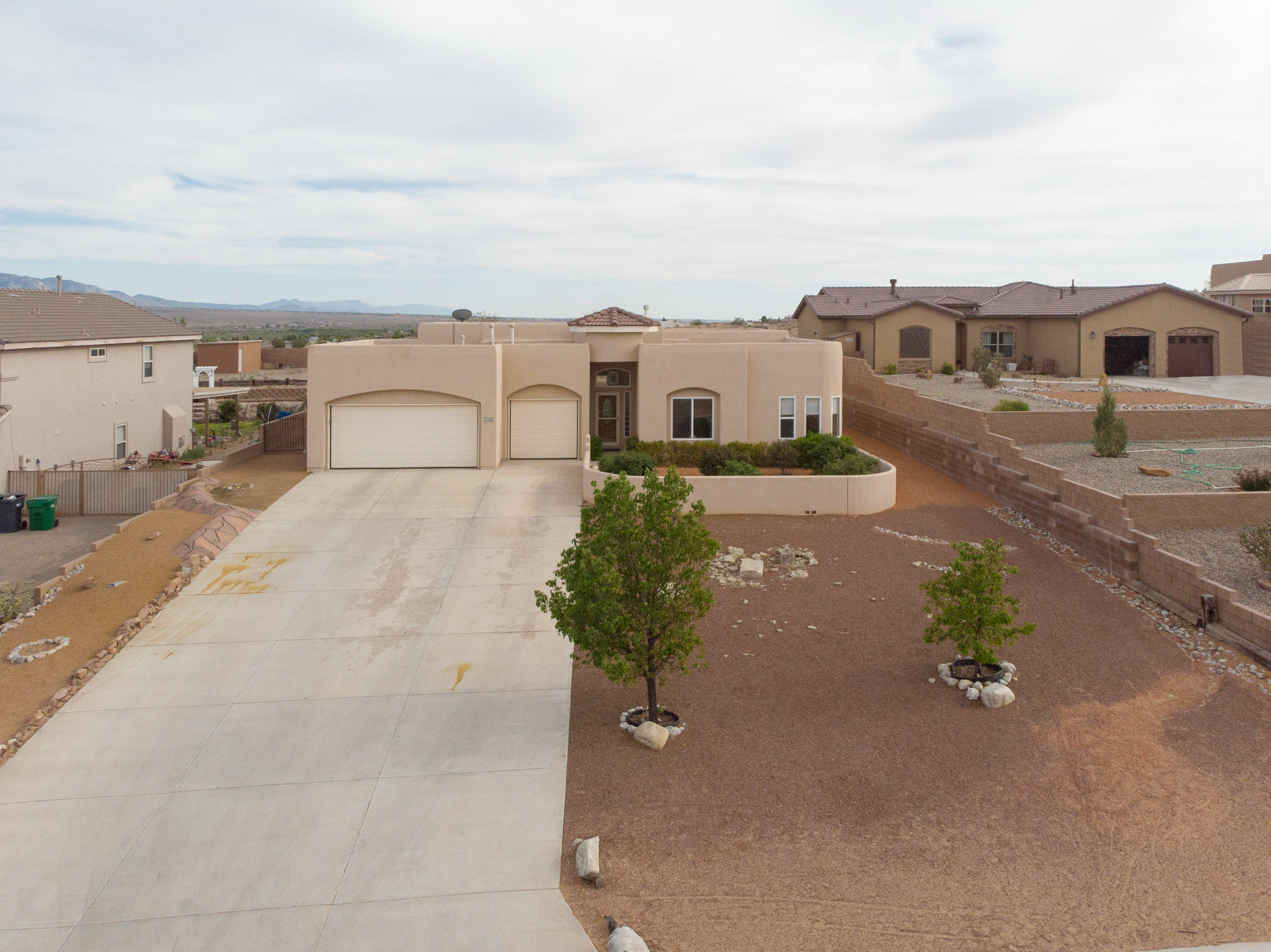 You will love this impeccably maintained home on .5 acre with gorgeous mountain views! The living area features vigas, a kiva fireplace and is open to the kitchen and breakfast nook. The extra large 4th bedroom can be used as a den or game room. You will love the covered patio and views of the Sandias and city lights! Past the retaining wall in the backyard is more space left to your imagination. Solar was installed a year ago, is being financed and will be paid off at closing.