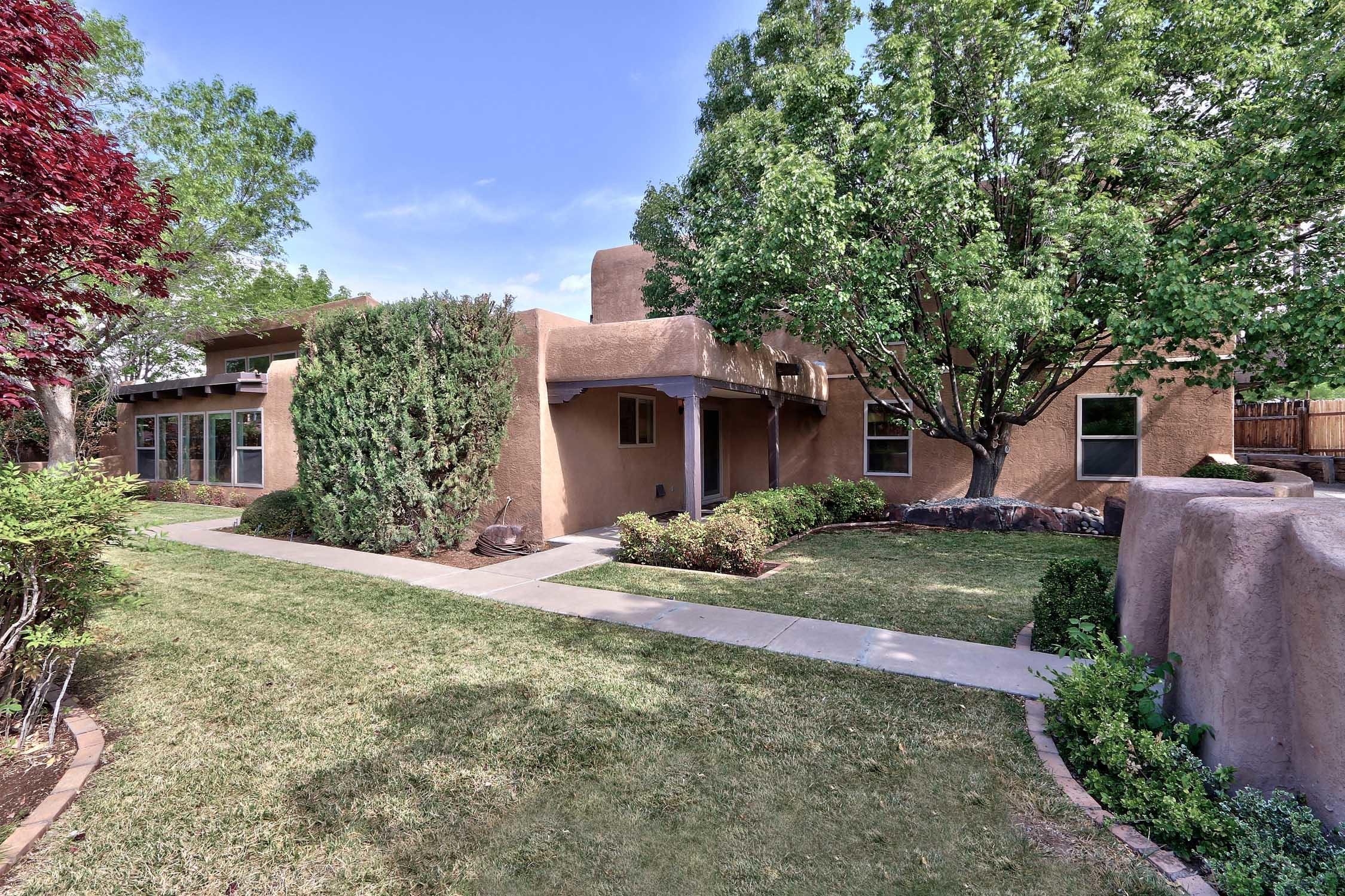 Extraordinary North Valley custom home set in a beautiful neighborhood on close to 1/2 acre of mature trees, grass & even a putting green. Completely renovated &  flooded w/ light, the home boasts new tile flooring, new carpets, renovated kitchen w/ sparkling SS appliances, updated bathrooms & new paint. 2  new refrigerated air units & 2 spacious master suites, one downstairs. The upstairs master boasts a large walk-in closet, renovated bath w/ 2 sinks & a balcony from which to enjoy stunning mountain views. The property's 10-car garage is a car lovers dream w/ one huge (8 car) separate garage & an attached 2-car garage w/ epoxy-finished floors. Perfect hard-to-find space for a car collector, workshop or hobbyist. Bring your cars & green thumb to this private oasis close to all amenities!