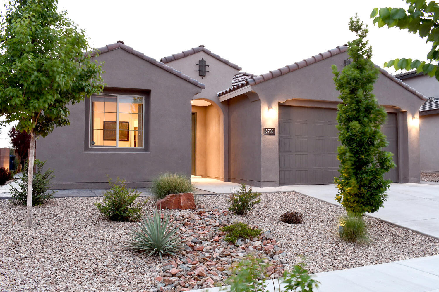 Beautiful Like New Darden Floorplan for sale in the sought after NE Community of Alameda Crossing. Home is in the La Cueva school district in a gated community. Open floorplan, chef kitchen, with quartz countertops in kitchen and stainless steel appliances. Plenty of storage in the oversized 2 1/2 car garage. Extended stamped/colored concrete patio in front and back with full wrap around sidewalk, commercial-grade acrylic sealant.  Full landscaping: front and back, sprinkler system in back yard, plant drips throughout, multi-zone sprinkler system w/timer.   The seller has added many improvement to include a security system, back yard landscaping, custom window treatments and more! See this home today before it is gone.......