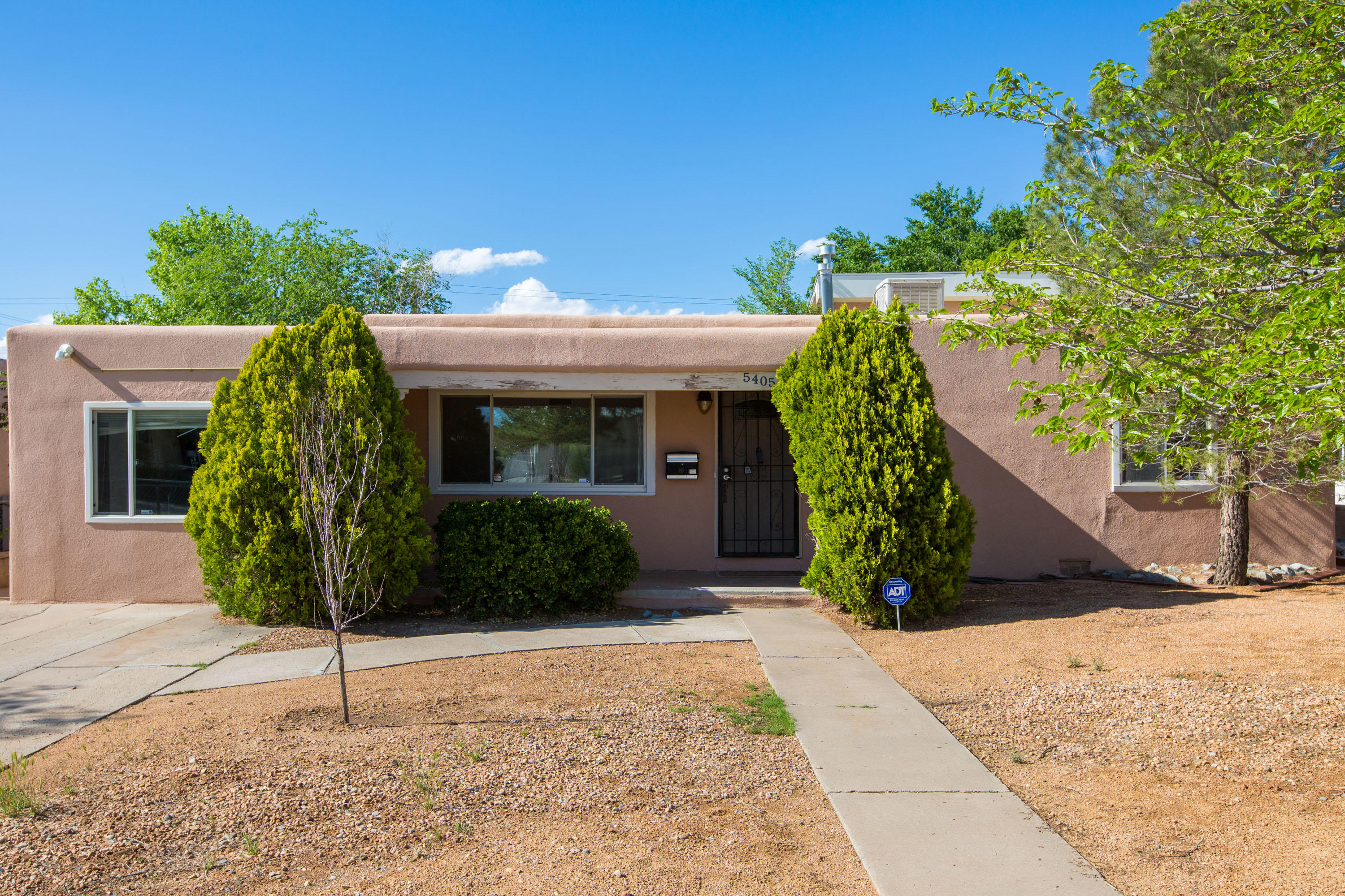Beautiful single story home located in the Albuquerque Highlands community! Home features 1,698sf with 3 bedrooms and 2 full bathrooms. Spacious living area with gleaming hardwood floors and the perfect natural light from the large picture window. Great eat-in kitchen with white cabinetry, ample counter space, custom backsplash, stainless steel range and microwave, dishwasher and fridge plus kitchen pantry. Owner suite with his/hers closets and a private bath. Bath hosts dual sinks, an over-sized vanity, framed mirrors and a shower/tub combo with tile surround. Huge fully fenced backyard with 2 storage sheds and a patio with pergola!