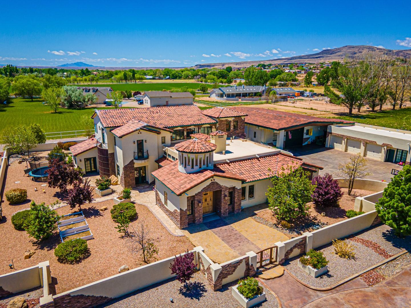 Amazing custom home on 2 acres in the heart of Los Lunas.  Features 7,420 sq ft, 4 bedrooms, 4.5 baths.  Two living areas, pool room, office/library, wine room, formal dining room.  Kitchen has custom cabinets, granite counter tops, under & over cabinet lights, island w/6-burner cooktop, double oven, Jenn-Air appliances & breakfast nook.  Master Suite has huge walk-in closet w/washer & dryer, sitting/exercise room w/mini bar, wine cooler, sink.  Master bath has jacuzzi tub, separate shower, double sink vanity.  In-ground pool is heated & has covered hot tub.  3-car detached garage is finished w/cabinets & huge connected storage room.  Another oversized detached garage has 2 bays and holds RV.  3-car attached garage has tile flooring, custom cabinets & water line for refrigerator.