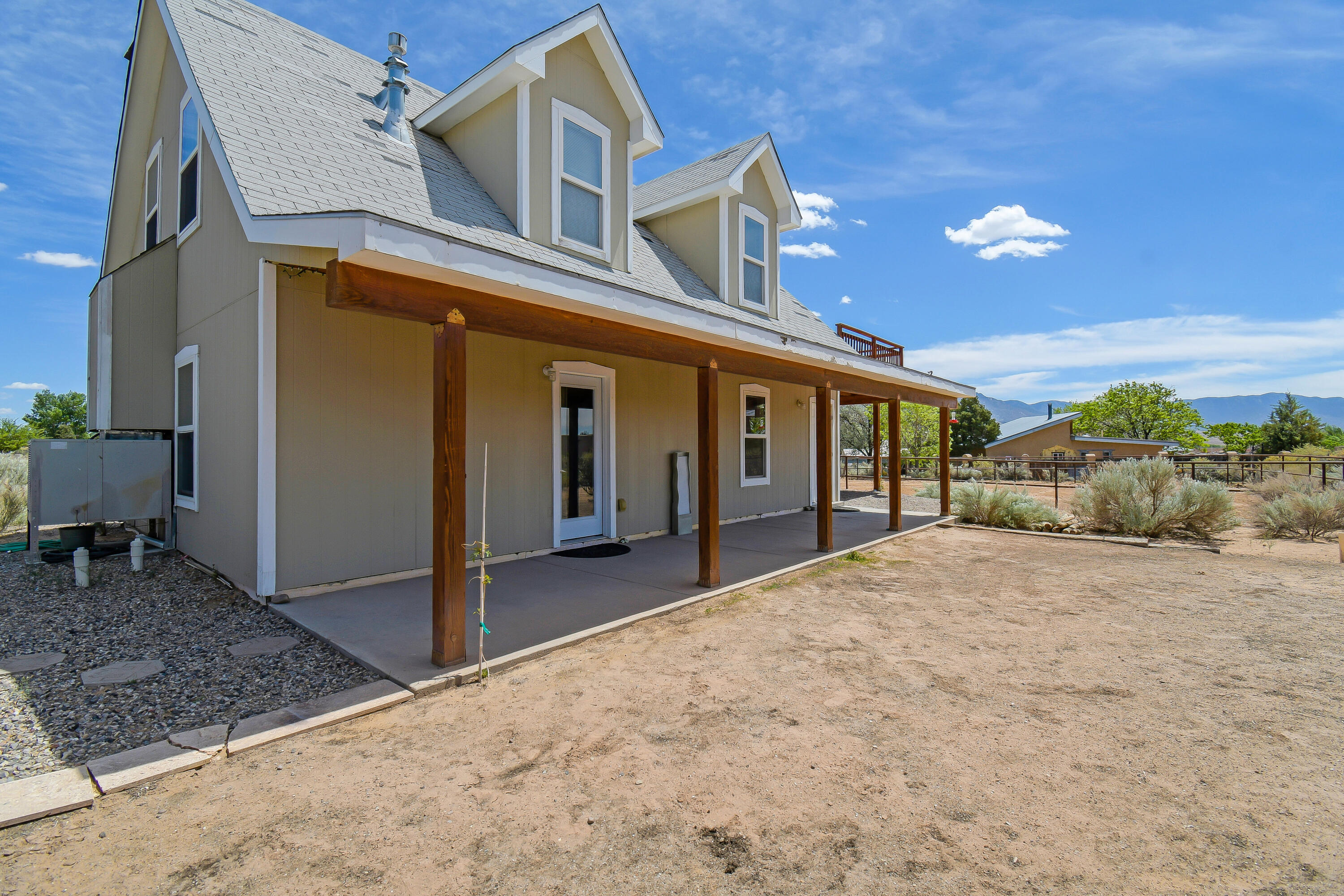 First Showings at Debut Open House, Saturday May 15th, 1-3 pm. Perfect multi-gen property and great Corrales horse setup on 1 acre with 1/3 acre brand new pipe fence paddock / arena plus a 12' x 36' Barn with two 12' x 12' stalls and 12' x 12' hay storage, separate shed for tack storage. Upper level  studio features a good sized kitchen, eating area, 3/4 bath, bedroom nook plus a million dollar Sandia Mountain View from the large deck. The main level boasts a spacious 1 bedroom with luxurious full bath, living room and efficient kitchen and a lovely south covered portale. Upper and lower levels can be separate or used together. Common main level laundry area.  Many new trees have been planted. This is a great opportunity to make your affordable move to Corrales!