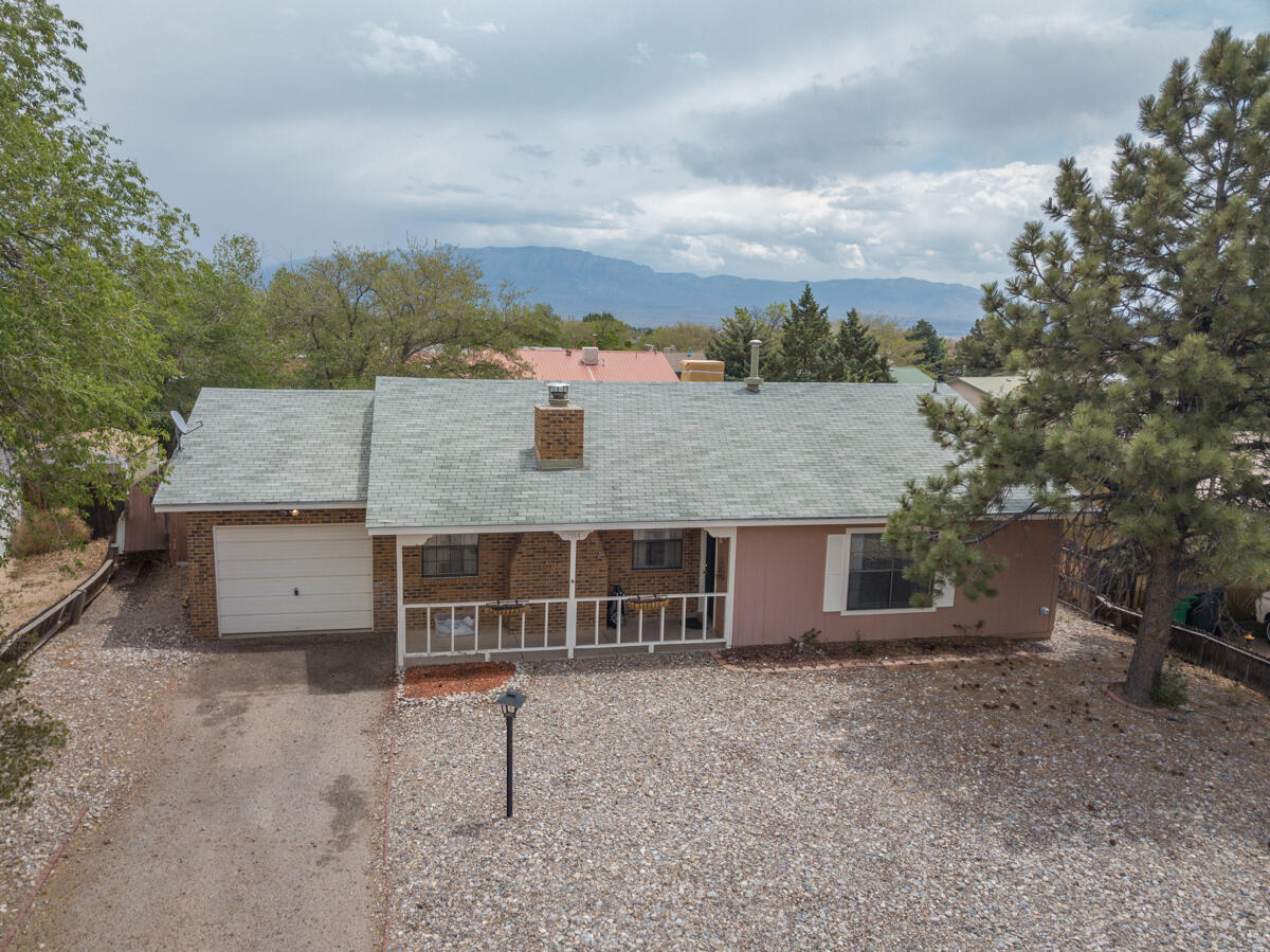 Just what you need. Minutes away from the heart of Rio Rancho. Shopping, food, and parks. This lovely home has a wide open living area with great floors. Brick front ranch style home nestled into a wonderful community. 3 bedrooms and 2 baths. Large mature trees that will provide shade and color year round. Enjoy your large backyard as you watch the balloons float overhead. Unique floorplan and spacious backyard are  great for entertaining. Make your way home and see what you've been missing!