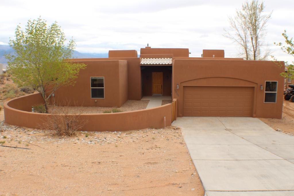 Custom single story, outstanding workmanship situated on .5 acre lot. Enjoy the splendor of the Sandia mountains sunrise and watermelon sunsets. Wonderful open floor plan, spacious family room with corner kiva fireplace, formal dining and breakfast nook with an amazing view.  Walk-in pantry, island with seating and custom details abound. Master bedroom features gorgeous ensuite with large jacuzzi tub. Outdoor enclosed backyard with three covered patios front and back.Refrigerated air , central heat and central vacuum system. Independent well for water cost savings. Excellent schools!