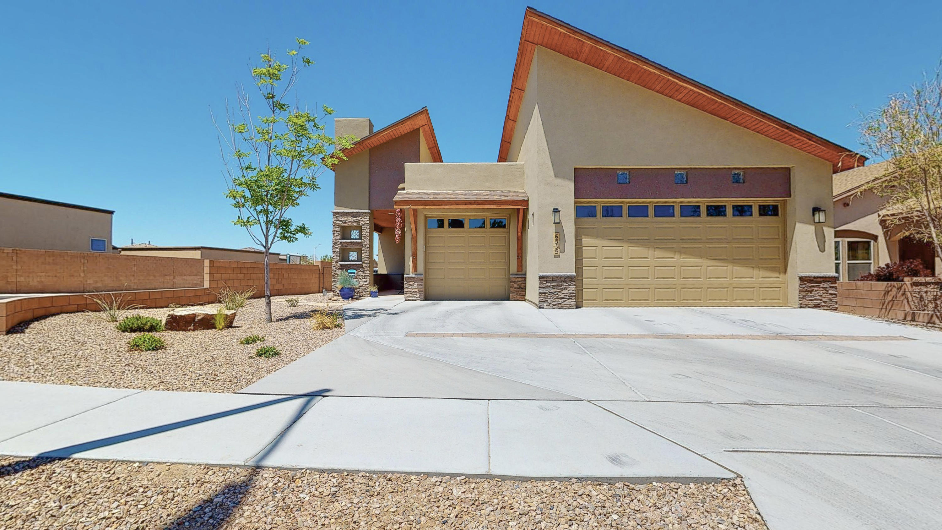 This contemporary southwest style home has an open floor plan ideal for entertaining. Gorgeous cabinets throughout. Enormous walk in closet in the master bedroom. Soft release cabinets in the kitchen. New granite counter tops in the kitchen and bathrooms. New wood tile throughout the living areas. Interior was recently painted. New doorknobs and lighting fixtures. Backyard professionally landscaped with drop system and the custom viga in the backyard has retractable shades. Driveway was extended to make it easier to pull out of the 3 car garage. Green certified home with energy star appliances! Flat and shingle roof was replaced last year as well as the gutters on the back of the house. This house is turn-key ready! Don't wait, view it today! See full list of upgrades attached.