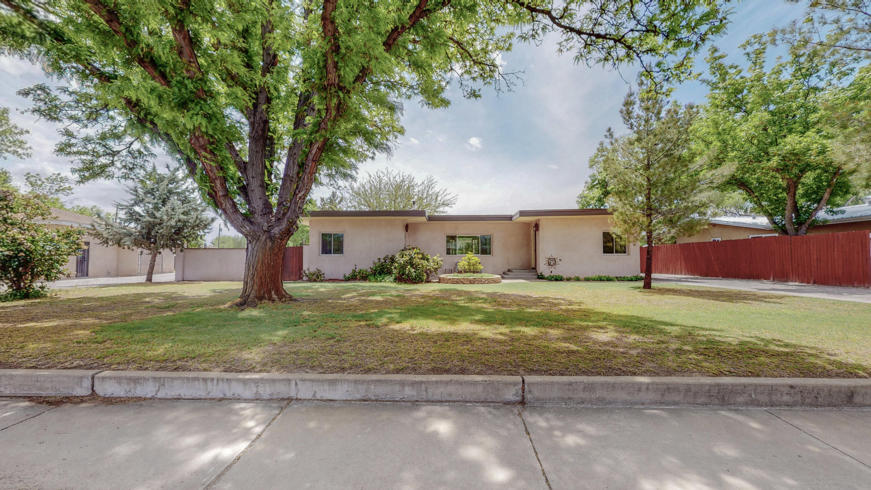 Beautiful home and property!! On almost 3/4 of an acre. Well maintained...with hard wood, tile, & travertine floors, granite kitchen countertop, open floorplan, huge windows, drive-thru garage, storage shed/workshop, hot tub, owned solar, irrigation well, and with backyard access. The possibilities with this home are endless! OPEN HOUSE on Saturday from 10 am-noon.