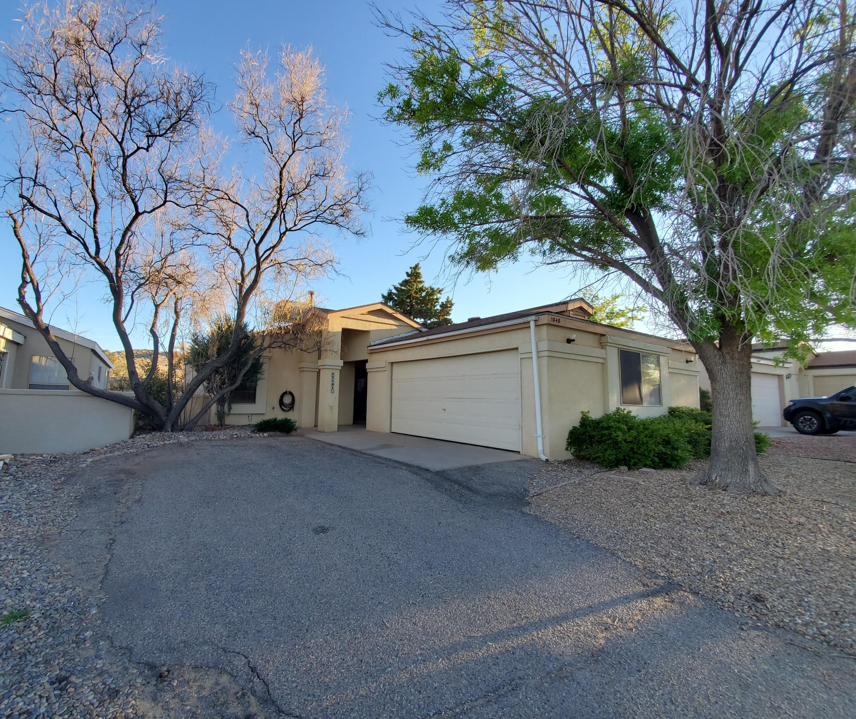 Beautiful updated home with 2 bedroom 2 bath and a 2 car finished garage. House is move in ready refrigerator, washer and  dryer are included.  Raised ceilings, open floor plan and tile in all areas but bedrooms. Bedroom closets are large with plenty of space for your items! The HOA maintains the front landscaping for easy living. Come see this new listing today!