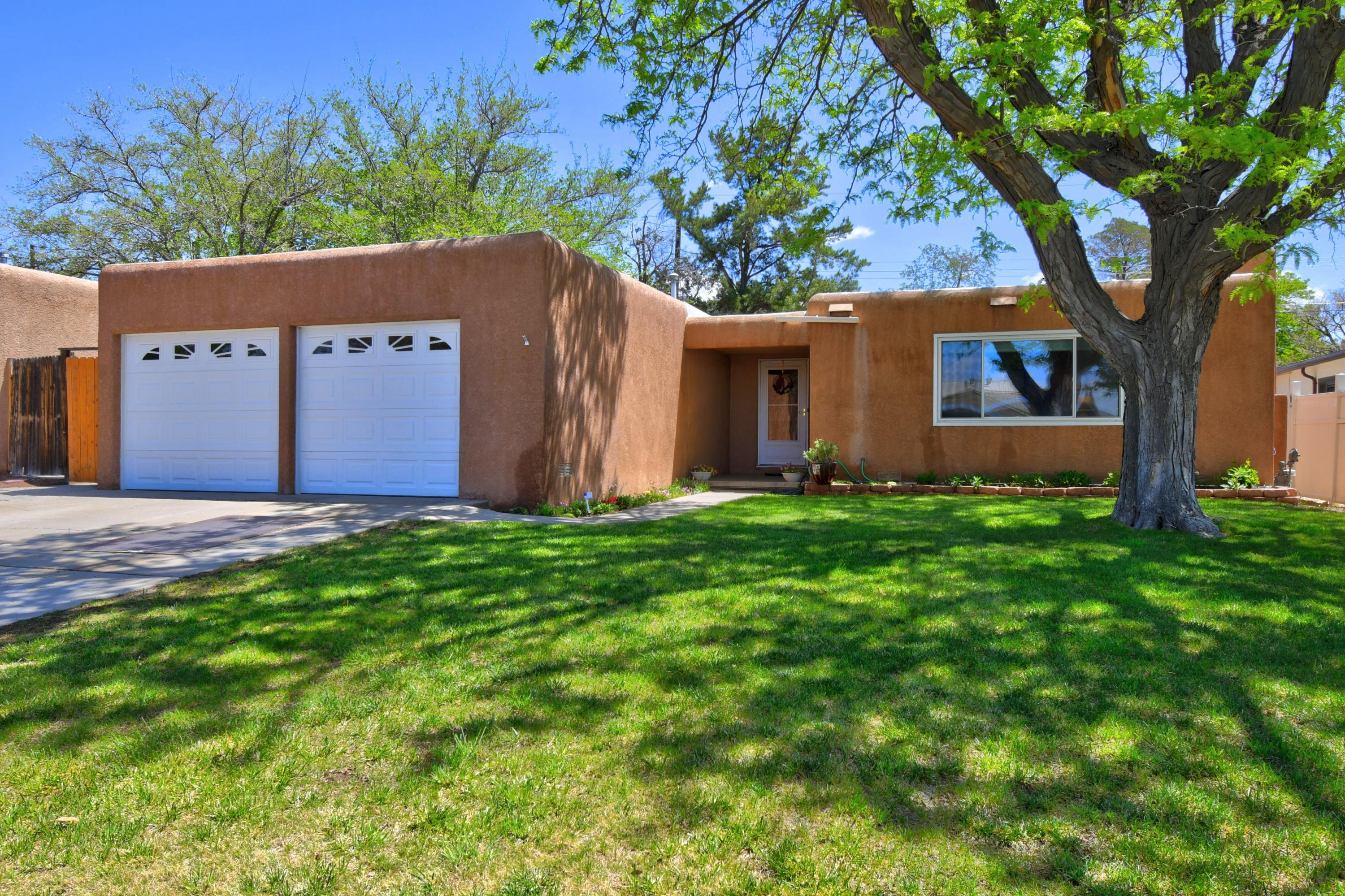 Beautiful single story home with an updated kitchen featuring granite countertops & a lovely custom backsplash. plus an island & soft close drawers & cabinets which offer storage galore. Matching appliances & newer gas stove (2020) Tile through out the entryway, kitchen and hallway. Two spacious living rooms. Double paned windows plus skylights bring light throughout the home. Tastefully updated bathrooms with tiled showers & newer vanities  All bedrooms feature remote controlled fans & built in drawers Step outside into a large covered patio perfect for entertaining. And a newer shed (2020) in the backyard for extra storage. Rheem furnace &  MasterCool  AC unit. The carpet in the living room & bedrooms have hardwood floors underneath.  Don't miss this meticulously maintained home!