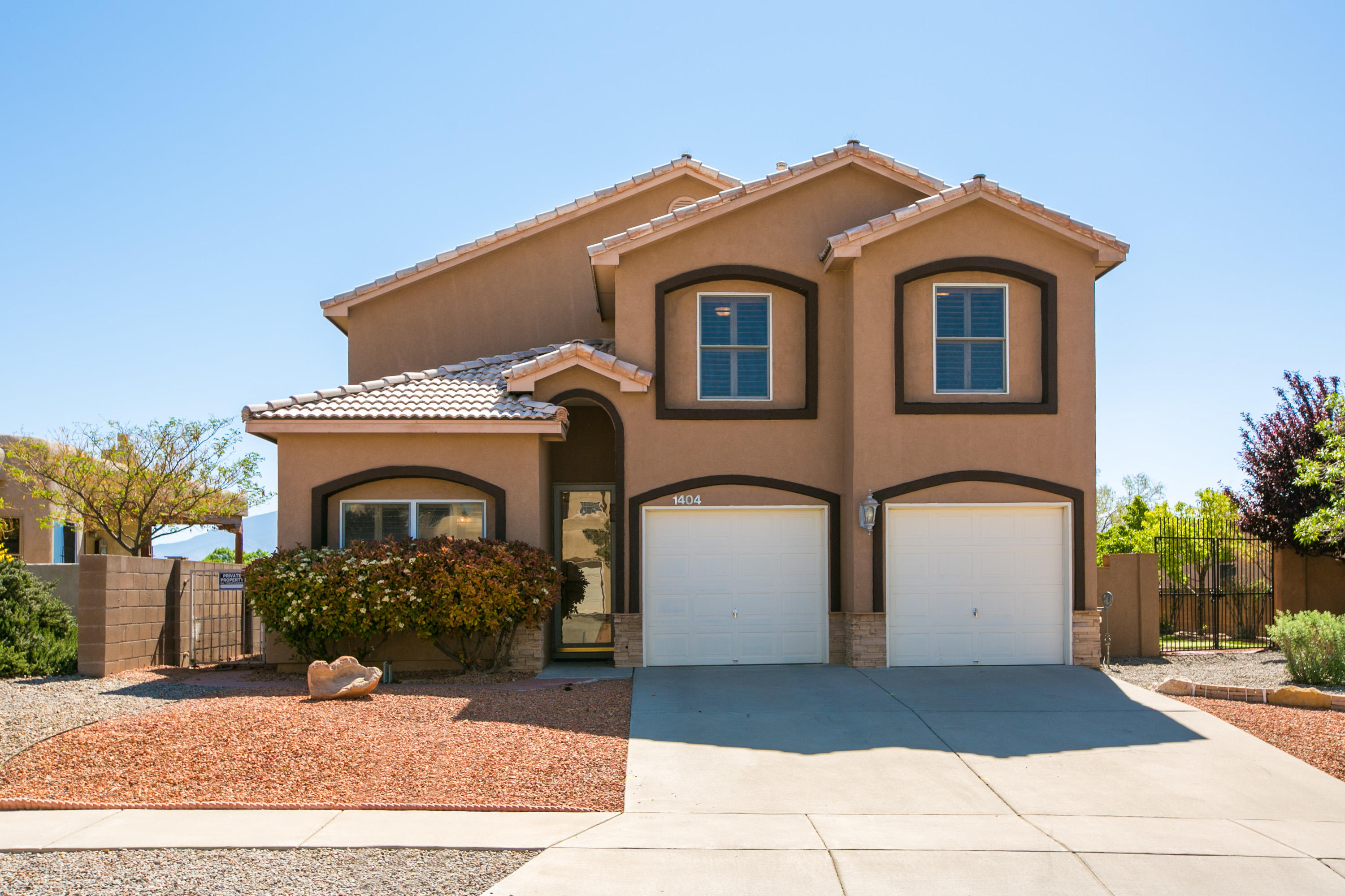 Gorgeous custom built Collatz home with amazing views of the Sandia's, located in the Trinity Estates community of Rio Rancho. Home features 2,841sf with 4 bedrooms, 3.5 bathrooms and multiple living areas! Beautiful Turkish travertine floors through this great open floor plan. Front living with a built-in media wall and wood beams. Open kitchen with custom cabinetry, granite countertops, gas range, microwave, dishwasher, refrigerator, pantry, center island and breakfast nook. Living space with a gas fireplace and wet bar! 1st floor guest suite or perfect home office. Hand crafted stair case leads up to the owners suite with 2 sided fireplace, sunroom and bath! Bath host his/hers sinks, a jetted tub & walk-in shower! Wonderful backyard with putting greens a covered patio & mountain views!