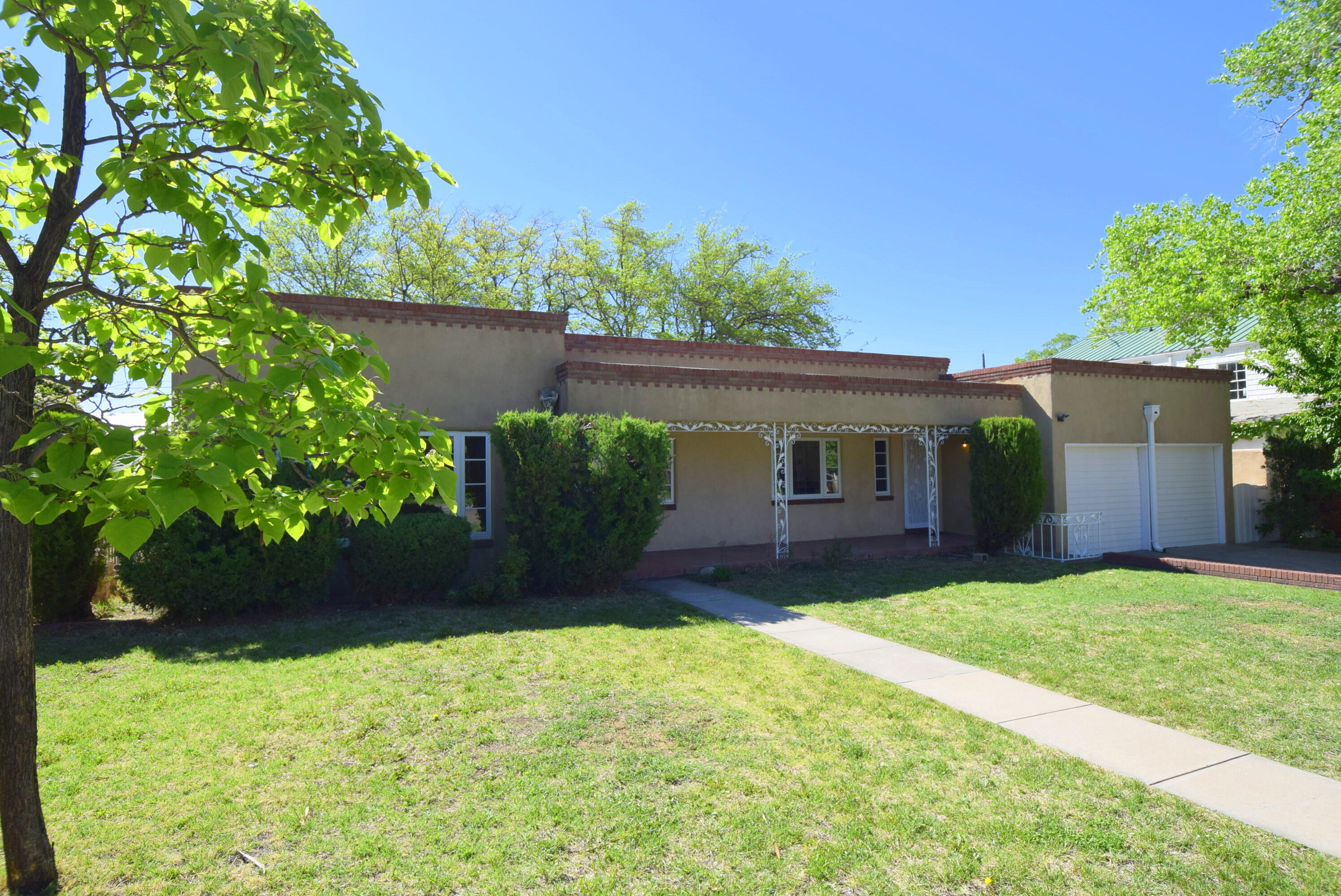 Territorial Style Home located in the heart of Nob Hill!  Beautiful and convenient location near UNM, Shopping, Restaurants, Schools &  Hospitals.  Updated Single Story 4 Bedroom home has a large Living room w/ gleaming Hardwood floors, Coved Ceilings & Charming fireplace.  Large Dining room has picture window, Hardwood floors  perfect for entertaining!  Updated Kitchen includes  Granite counter tops, Stainless steel appliances, light & plumbing fixtures.  Don't miss the additional storage in bedrooms and hallway.  Large 4th bedroom could be a  secondary living room.  All Windows replaced in beautiful condition!  Spacious rooms are perfect for Large family!  Huge back yard with flagstone  patio.  Large Shade trees perfect for outdoor summer nights. Monte Vista Elementary blocks away.