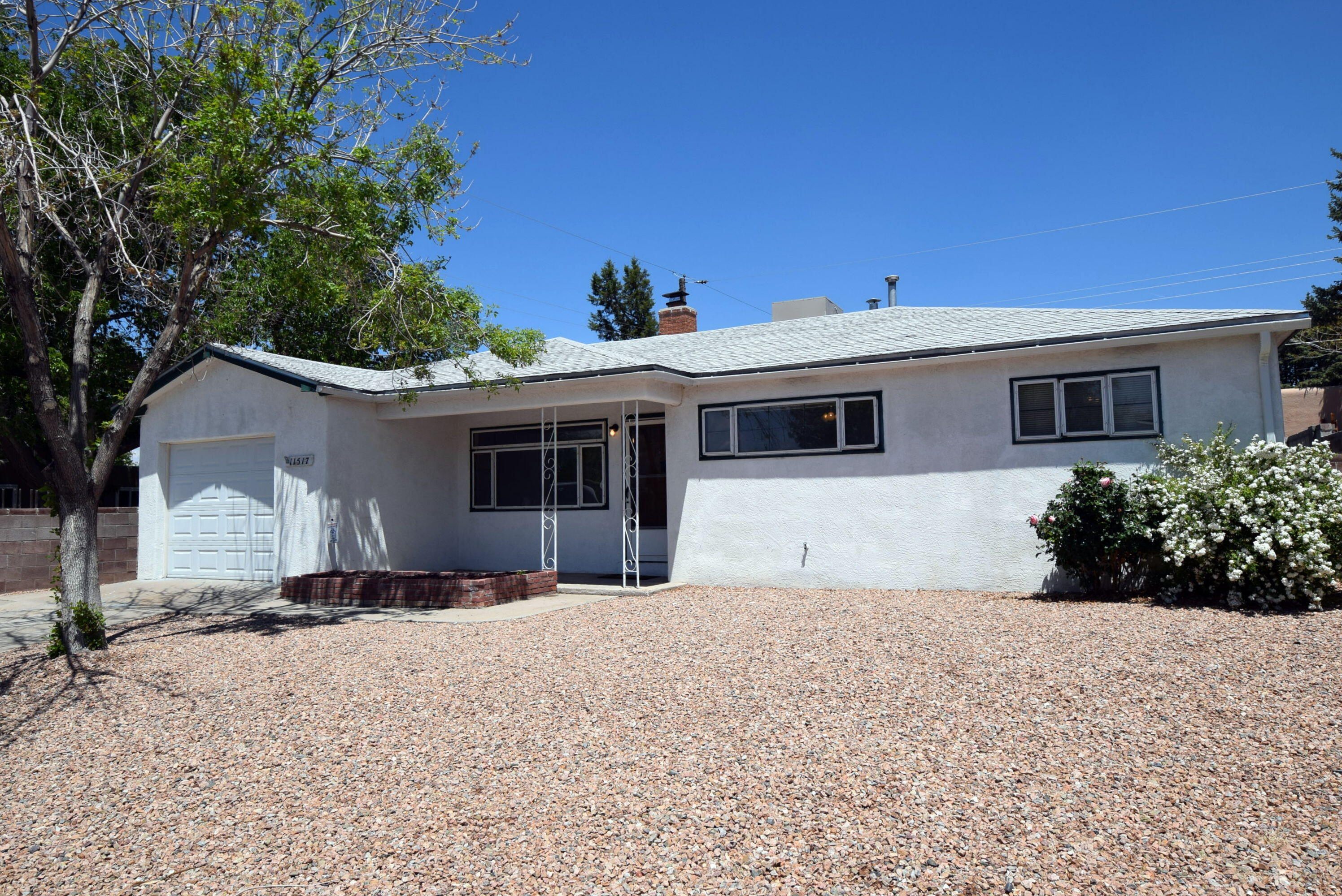 Gorgeous single level home in a well established neighborhood. Updates include flooring, remodeled kitchen and bathrooms. Sunroom (not heated )is approximately 241 sq ft additional. Close proximity to Kirtland Air Force Base, Sandia Labs, shopping, and restaurants.