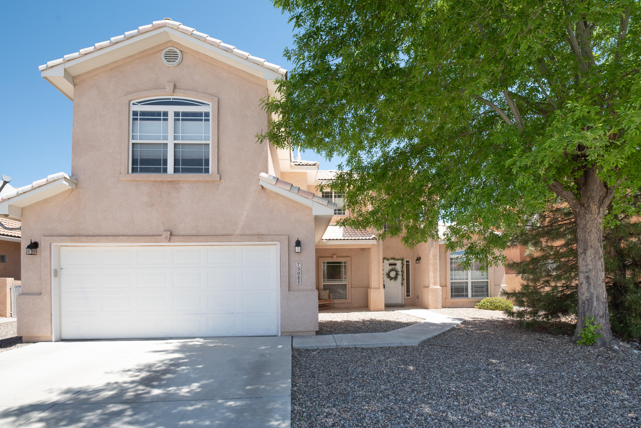 Beautiful 5 bedroom Stillbrooke home in highly sought after planned community! Main level features grand open floorplan w/gorgeous custom staircase; spacious great room opens onto breakfast nook & kitchen w/granite countertops, island & breakfast bar. Cathedral ceilings & Clerestory windows makes this home bright & light. Flexible floorplan could be 2 living areas: office & 5 bedroom plus loft, OR formal dining, greatroom, 5 bedrooms & loft/media area. Master suite on main level has backyard access, spa like en suite & huge walk-in closet. Also, a secondary bedroom on main level. Upstairs features a huge loft/media room, 3 more very large bedrooms, & additional full bathroom. Lovely landscaped backyard w/water feature & fully walled for privacy. New carpet 2019, & updated SS appliances.