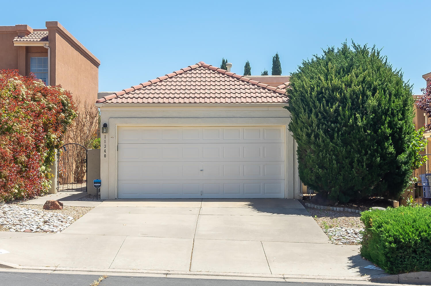 Lovely home, impeccably maintained with pride of ownership!!! Private courtyard with security gate leads to the front door! Step inside and experience a bright and light home with raised ceilings, clerestory windows, living room & family room sharing a 2-way gas log fireplace!  A spacious kitchen offers abundance of cabinetry, microwave, dishwasher, electric oven, roomy breakfast area & opens to the family room with an atrium door to the private backyard & large covered patio to enjoy the summertime bar-be-ques! Escape to the generous size master bedroom through double doors, with  a private patio! Master bathroom offers  double sinks, separate shower, garden tub and walk-in closet! Refrigerated air conditioning! Recent water heater!  NICE!