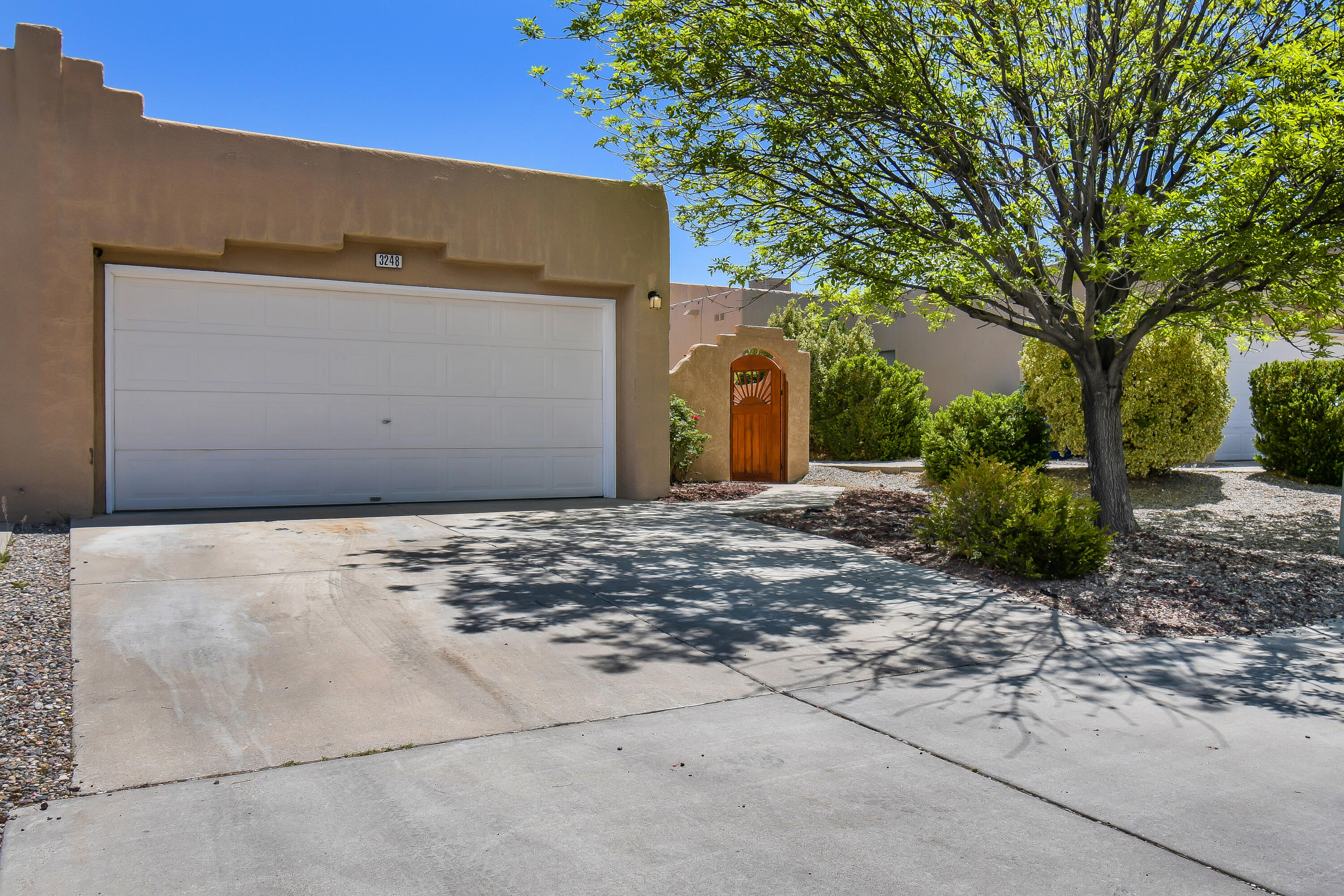 Nestled next to the historic and picturesque petroglyphs, enjoy living with cozy convenience in this open, bright and inviting 3 bedroom / 2 bath home.  The landscaped front courtyard welcomes you to step into comfortable living space with durable faux wood laminate floors, fireplace and tile kitchen.  The large private backyard will be an ideal setting for enjoying cool nights by the wood burning kiva or entertaining friends under your covered patio.  Stroll through nearby Rinconda Park or enjoy plenty of close-by shopping, restaurants and golf course.  Easy access to I-40 means you can travel from your serine environment to access everything Albuquerque offers.   Whether you work hard, play hard or just like to relax, this home will let you do it all with comfort and convenience.