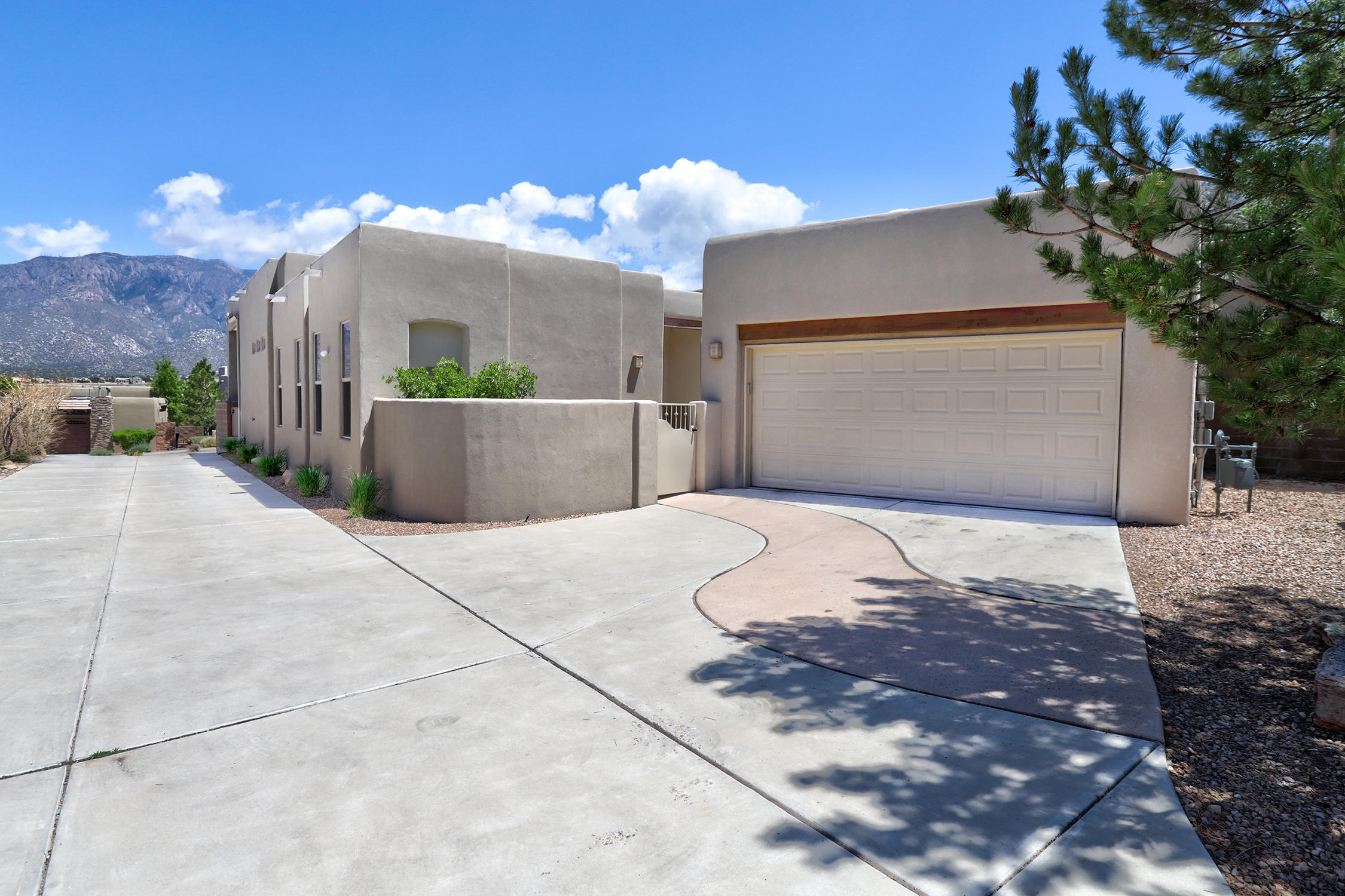 Enjoy Breathtaking Mountain and Sunset Views From This Beautiful High Desert Property! * Open Living Room/Dining Room/Kitchen Layout with a Wall of Windows Framing the Mountains * Generous Kitchen Includes Great Storage, Island, Stainless Steel Appliances, Bar Seating, and Pantry * Light Pours In Through the Windows and Skylights * Recently Installed Engineered Walnut Floors Are Beautiful! -- No Carpet! * Primary Bedroom with Views and a Spacious Bathroom with Double Vanities, Walk In Closet, Separate Shower and Soaking Tub * Enjoy the Views In the Outdoor Space Built For Entertaining with Built-In Grill, Bar Area, Water Feature, and Fire Pit * Two Additional Bedrooms Plus a Fourth Bedroom That Could be a Great Office or Den * Oversized Two Car Garage with Workshop/Storage Area