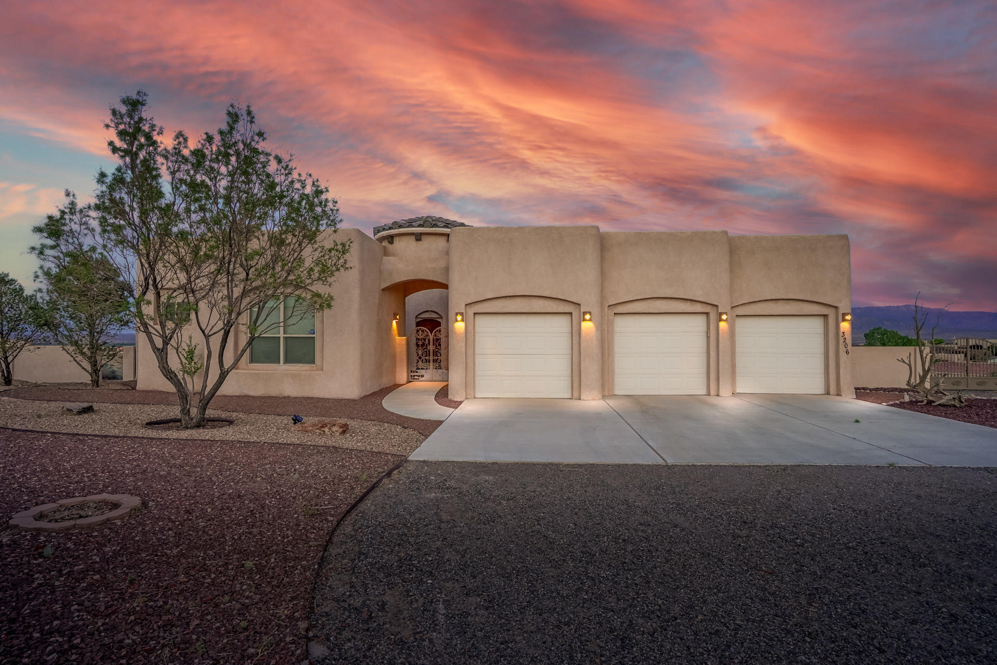 Open House Saturday 5/15 from 11-1 pm! Custom Santa Fe style home situated on .93 acres with must-see details! Private front courtyard, three-car garage, fantastic mountain views! Soaring ceilings with wood beam accents, kiva fireplace, built-in nichos! The spacious owner's suite features a wall of windows with an amazing view of the valley, Sandia and Santa Fe mountains! The owner's suite is located on the main level of the split-level floorplan. Stunning kitchen with gas cooktop, stainless steel appliances, and center Island! Large back patio space to sit and enjoy the Santa Fe and Sandia Mountain views! Enjoy the sunrise on the oversized Balcony with your morning cup of coffee. Take a virtual walkthrough tour today!
