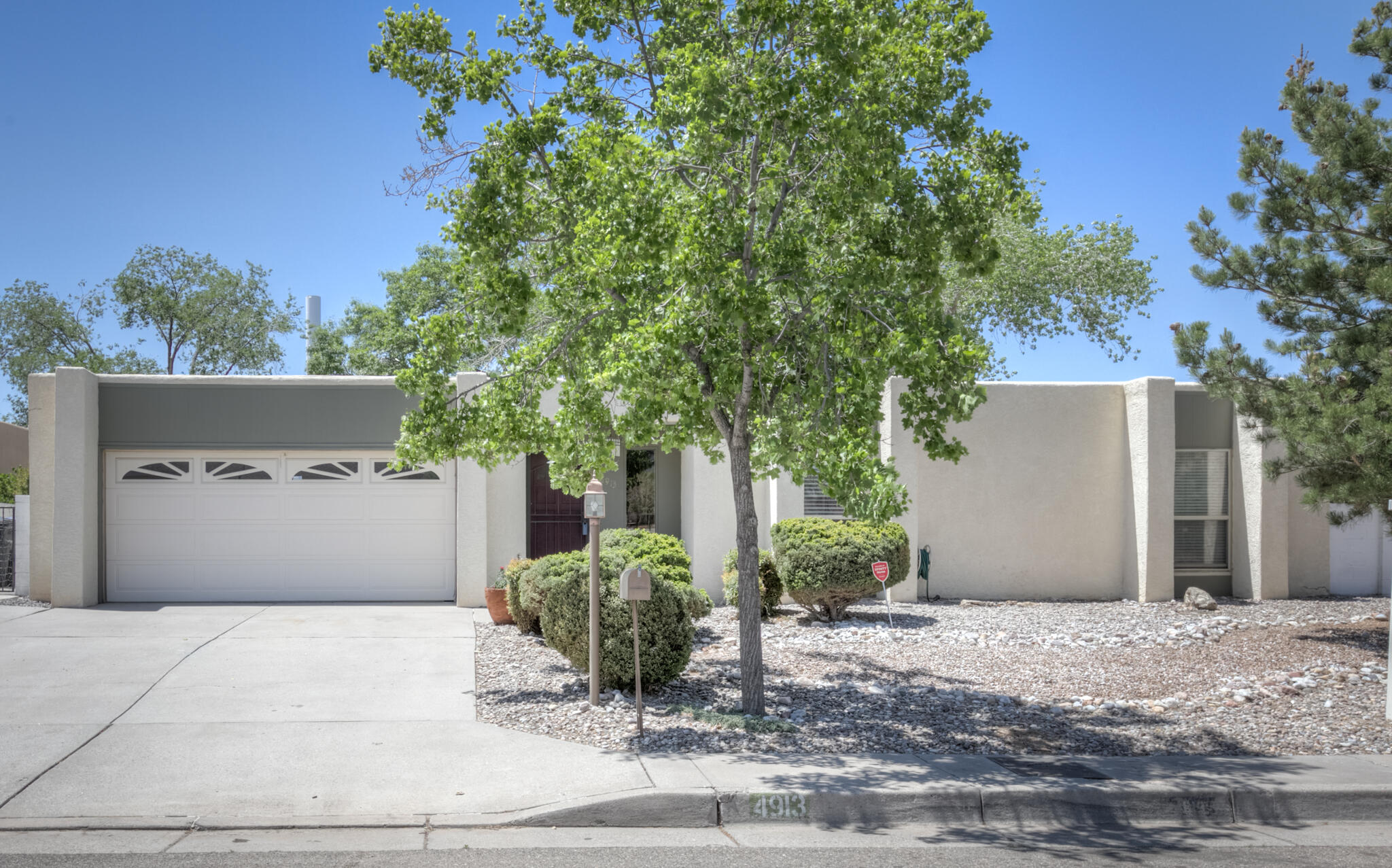 NE Heights single story with a fantastic layout! Offers two open living spaces & large dine in kitchen w/double ovens, tons of cabinetry & ample counter top space. The two living areas can be used as flex space for open living/office area or the Family Room can be easily converted to be a 5th bedroom! Master Bedroom is secluded from the other three bedrooms. The residence has ample storage with built in's throughout. The new owner is sure to love the private Park-like Backyard with mature shade trees, grass & outdoor living area! The outdoor living area has a grilling station, fireplace,fridge, built in bench seating and string lights.The south side of the house was once used as a green house & can be easily converted by new owner.Other amenities include;TPO roof, two evaporative coolers
