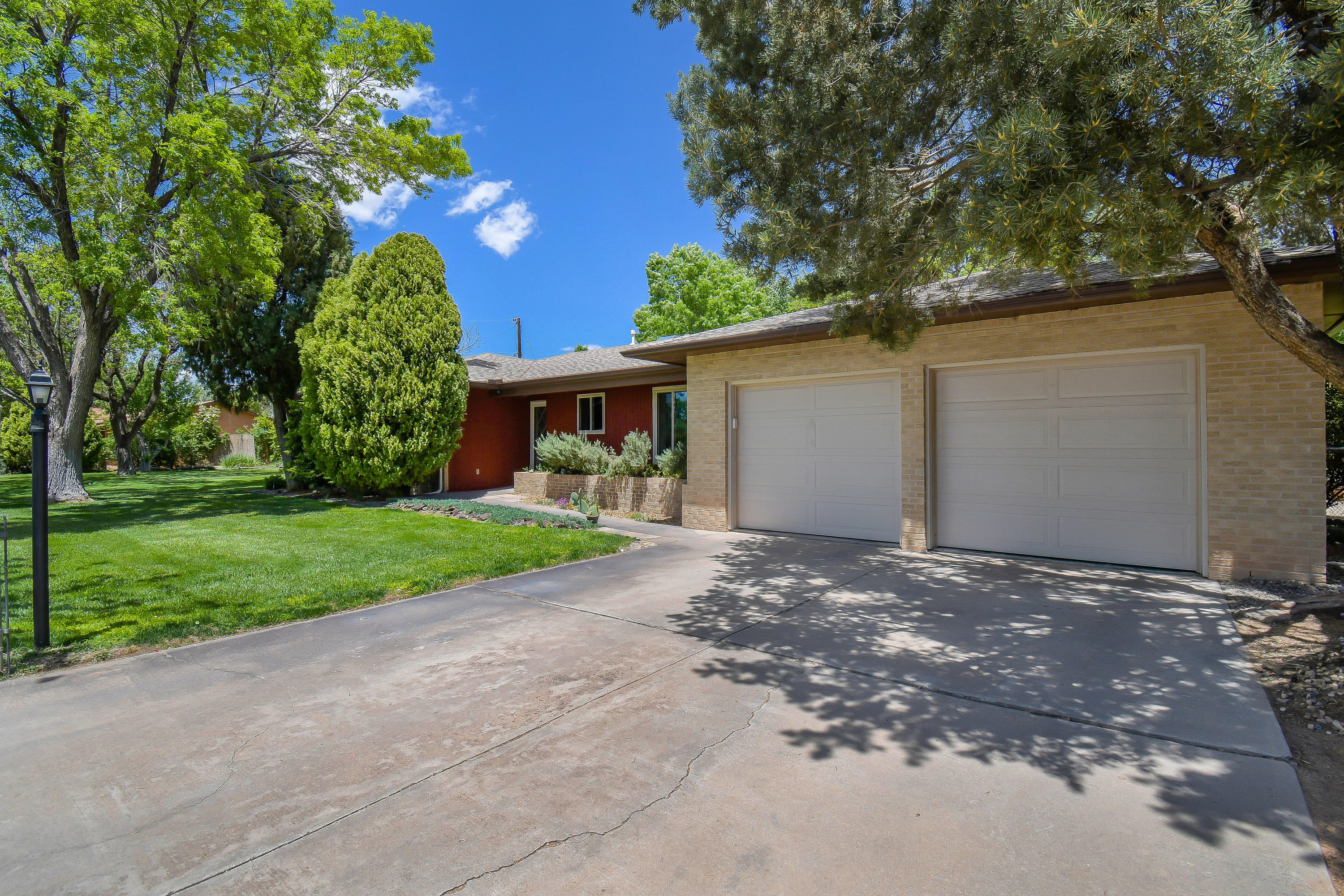 1st showings at Grande Open House Sun 5/16 from 1-3 pm. The North Valley at it's finest! Convenient location tucked on a quiet cul de sac. Beautifully renovated One Level 3 bedroom, 2 bath, 2 car garage on lush .66 acre with a new deep well to keep it green!  Artists, Craftsman, Yogi's don't miss the 32'x32' heated & cooled studio with attached 1 garage. Classic Refinished Oak wood flooring. OWNED Solar system. Stunning Chef's kitchen features smartly designed new cabinetry, granite counters and stainless appliances. Relaxing living area with a masonry gas log fireplace plus a flex space that connects the home to the heated sunroom filled with glass and outdoor inside. Mature trees, plants, bushes, fruit trees, mature landscaping, raised bed gardens. Quick access to I-25,Balloon Park, APO.