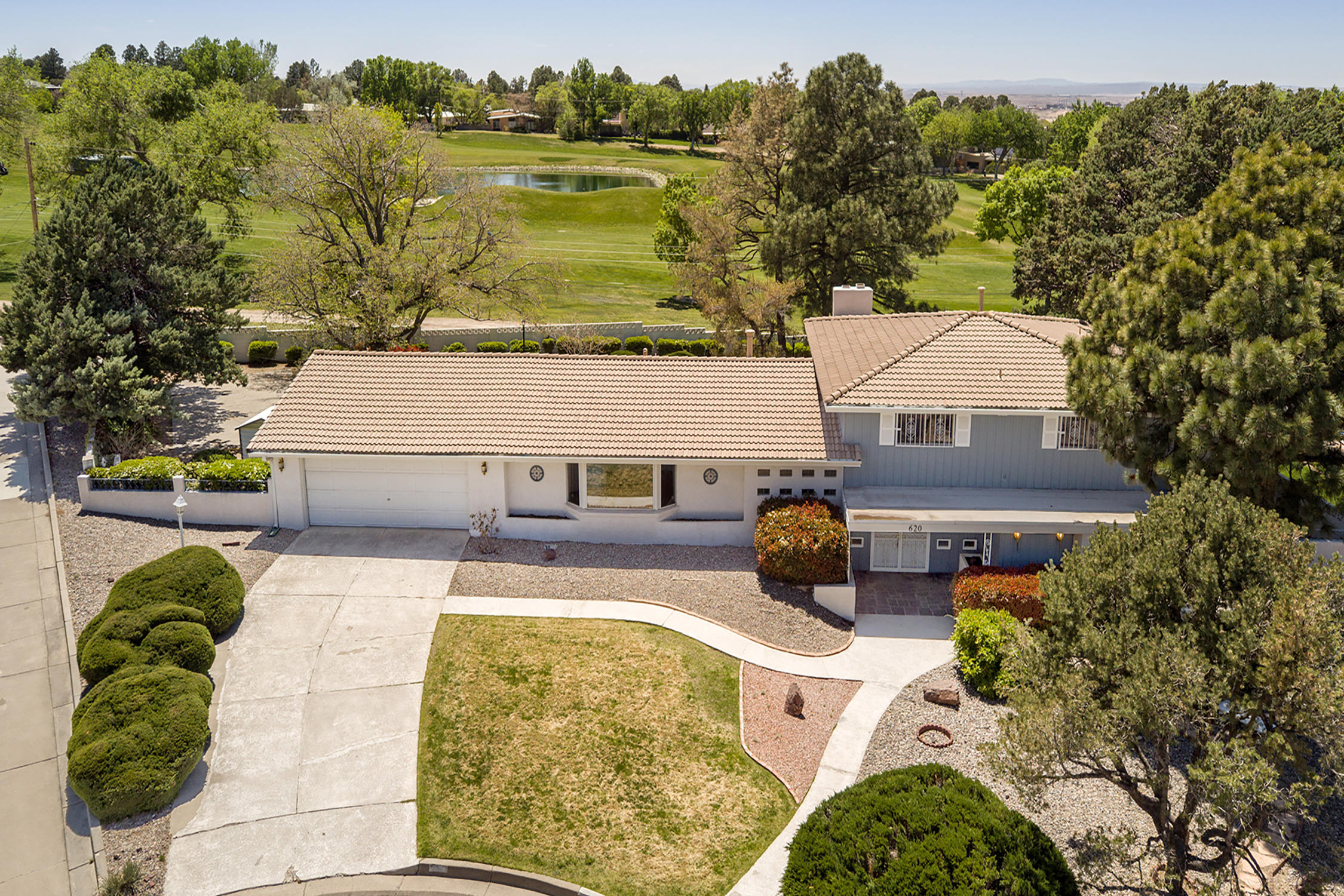 Spectacular Half Acre Golf Course  Cul-De-Sac Lot! * 4500+ Total Footage - ~3700 Above Grade Plus An Awesome Finished Basement * Expansive Floor Plan Includes Three Living Areas Plus a Den/Office/Study with a Bath * Eat-In Kitchen with Amazing Storage + Sub Zero Refrigerator * Upstairs Bedroom Wing Includes a Primary Suite with a Deck Looking Out Over the Golf Course and Three Separate Closets! *  Bedroom and Bath on Entry Level Could Be a Nice Guest Suite *  Use the Den/Office as a Bedroom for an Optional Second Guest Suite * Wood Floors in the Living Room and Dining Room * Great Mountain Views Out the Living Room Picture Window * Family Room with Bar and Sliders Out to the Back Yard * Basement Would Make an Amazing Media Room/Theatre * Endless Possibilities with This Special Property!