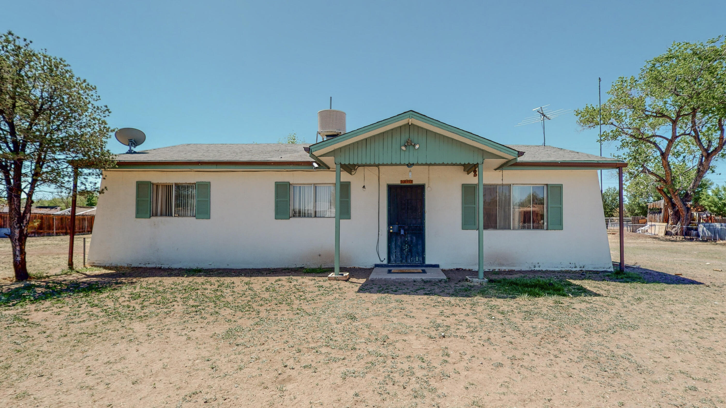 Ranch-style home set in the quiet south valley with a large lot.  Home is being solid ''as is.''