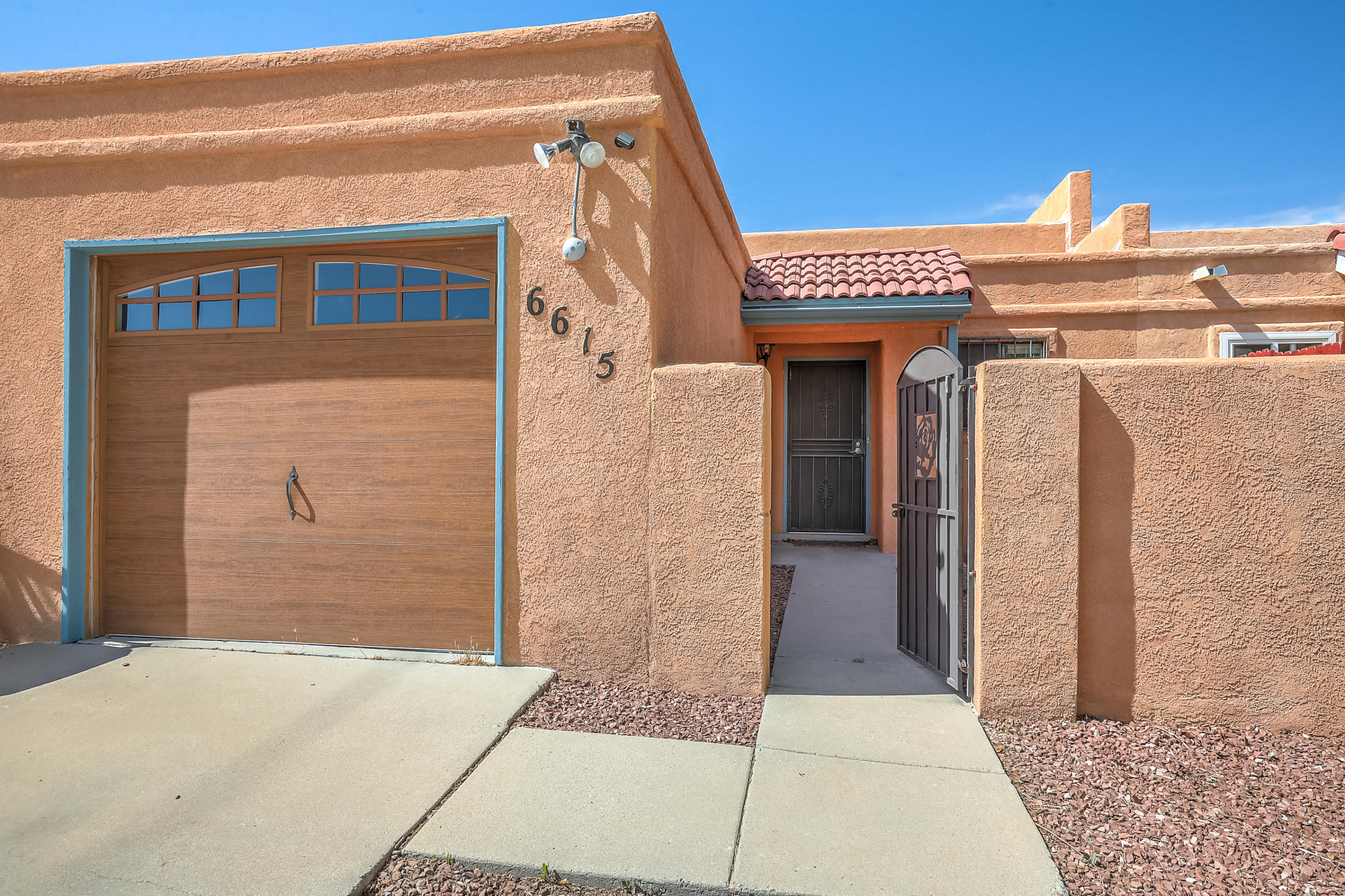 Beautiful Townhome located in Santa Fe Village community. Close to Santa Fe Village park.Home features - Great room with dining area, bright kitchen with dining room pass through, 2 bedrooms and 2 baths, Updated Furnace and evaporative cooler ,updated garage door and front courtyard with custom gates