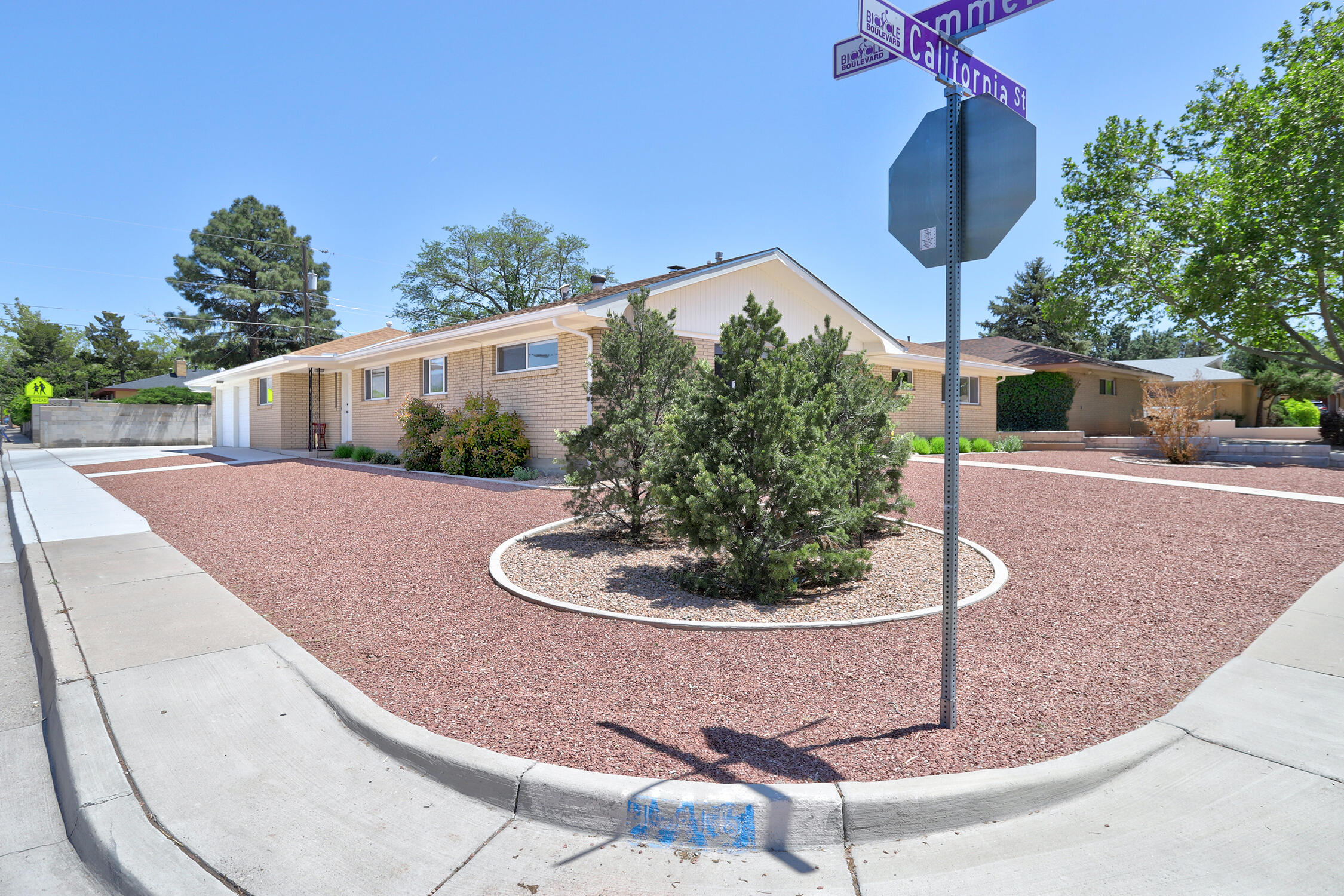 In a single word, - WoW!  Better than NEW updated home in established NE Heights neighborhood!  Light & Brightness shine through every room of this lovely remodeled home on a corner lot.  3 bedrooms plus  separate entrance w/bedroom/office + half bath perfect for home office or in-law quarters.  Newer windows, refrigerated A/C (2 combo units), wood (real wood) floors, electrical service, sewer line, updated kitchen, updated baths, and much more.    2 living areas. Remodeled kitchen w/new custom cabinets, granite & upgraded appliances.   Formal dining room + breakfast nook.   Heated & cooled sunroom perfect for gym, home school room, office or just relaxing.  Awesome backyard access w/gate & concrete pad.  Incredible storage throughout-Low maintenance yards front & back.
