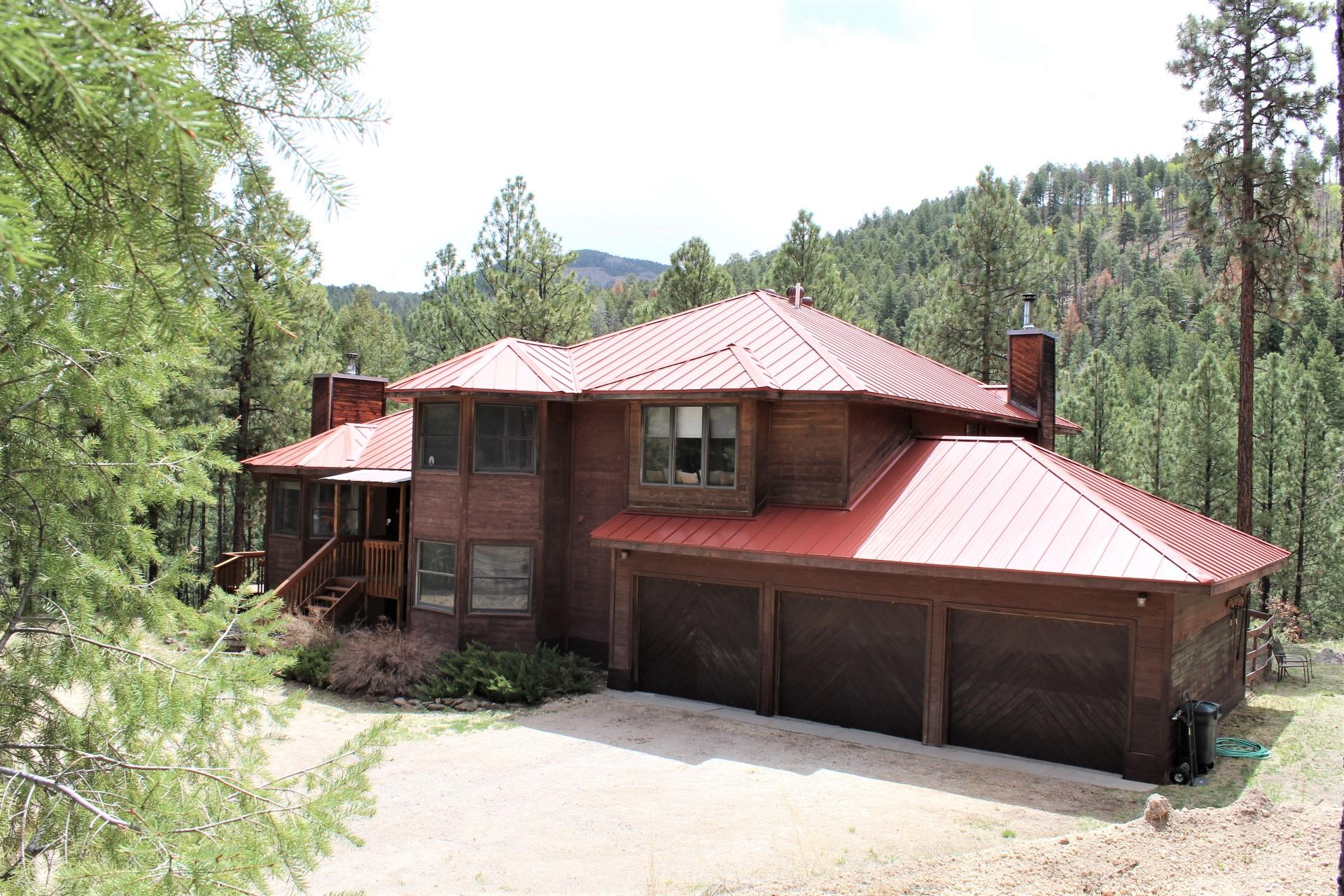 Jemez Mountain Hi-iigh!! Seriously...no kidding...where you feel like you have the forest all to yourself! Quiet & Delightful!! Unique Custom Home with room for everyone & everything to make a fabulous life in the mountains! Over 4000 sq ft AND a 3 car garage on over 5 acres of beautifully forested land. Well-arranged kitchen has eat-at-bar, dining area, loads of cabinet/pantry space, double oven & deck access. Formal Dining & Den access deck too! You're gonna love the view from the hot tub perch! Master has huge lovely bath with step in shower and jetted garden tub, sitting room/office & super sweet balcony for late night star-gazing! Basement Rec-Room & pool table can stay! Brand new septic! Come & Get It!!