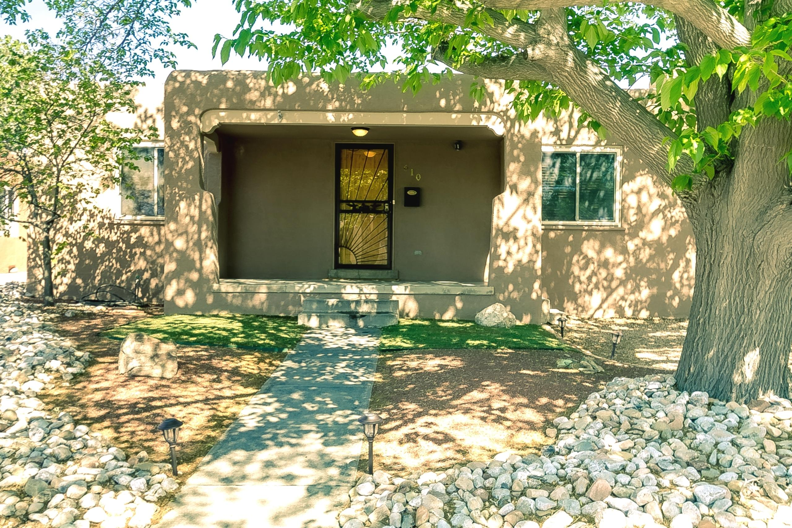 MONTE VISTA/NOB HILL! One level, 4 bedrooms, 1.75 baths and 1 car garage - a beautifully maintained Pueblo-style home close to UNM! Roof new in 2019. Combo HVAC (refrig air) with wrapped insulated ducts new in 2019. Water heater new in 2017. Oak hardwood floors + slate-look tile. Living room with gaslog FP. Open kitchen with maple cabs, granite counters, island with gas cooktop, double electric ovens, garden window, pantry and amazing storage. Dining room/flex room with tiled floor medallion. Separate master suite with walk-in closet + bath with shower and double sink vanity. Two sets of French doors open to oversized private backyard with deck, patio, forever lawn and Tuff Shed. One car garage with separate locking storage room. Extremely popular location!