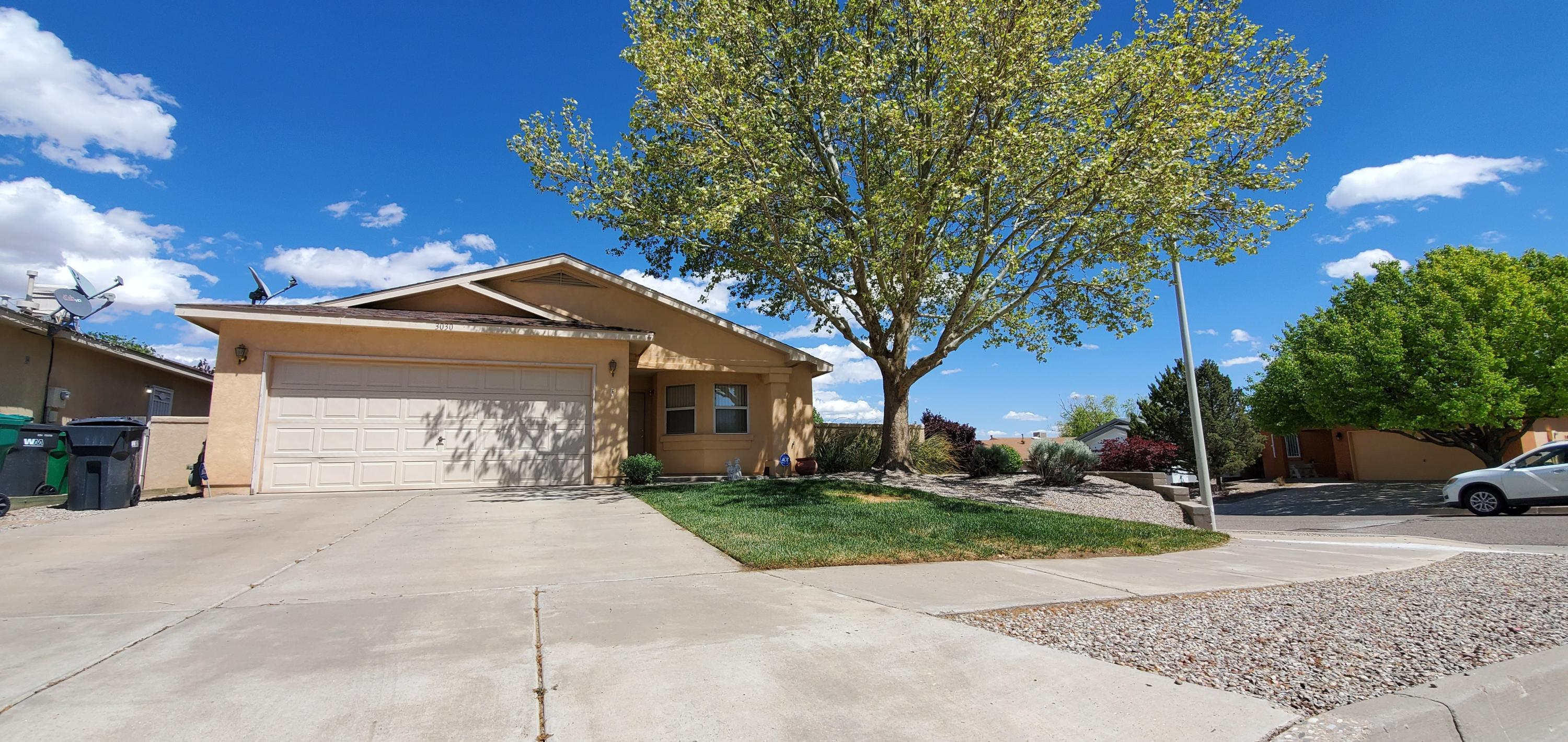 Beautiful single story 3 Bedroom 2 full bath home just became available for sale! 2 car garage - Beautiful landscaped backyard. Enjoy fabulous views of the Sandias from your flagstone back porch, Covered In Latillas And Vigas! House won't stay long in the market, send your bids ASAP