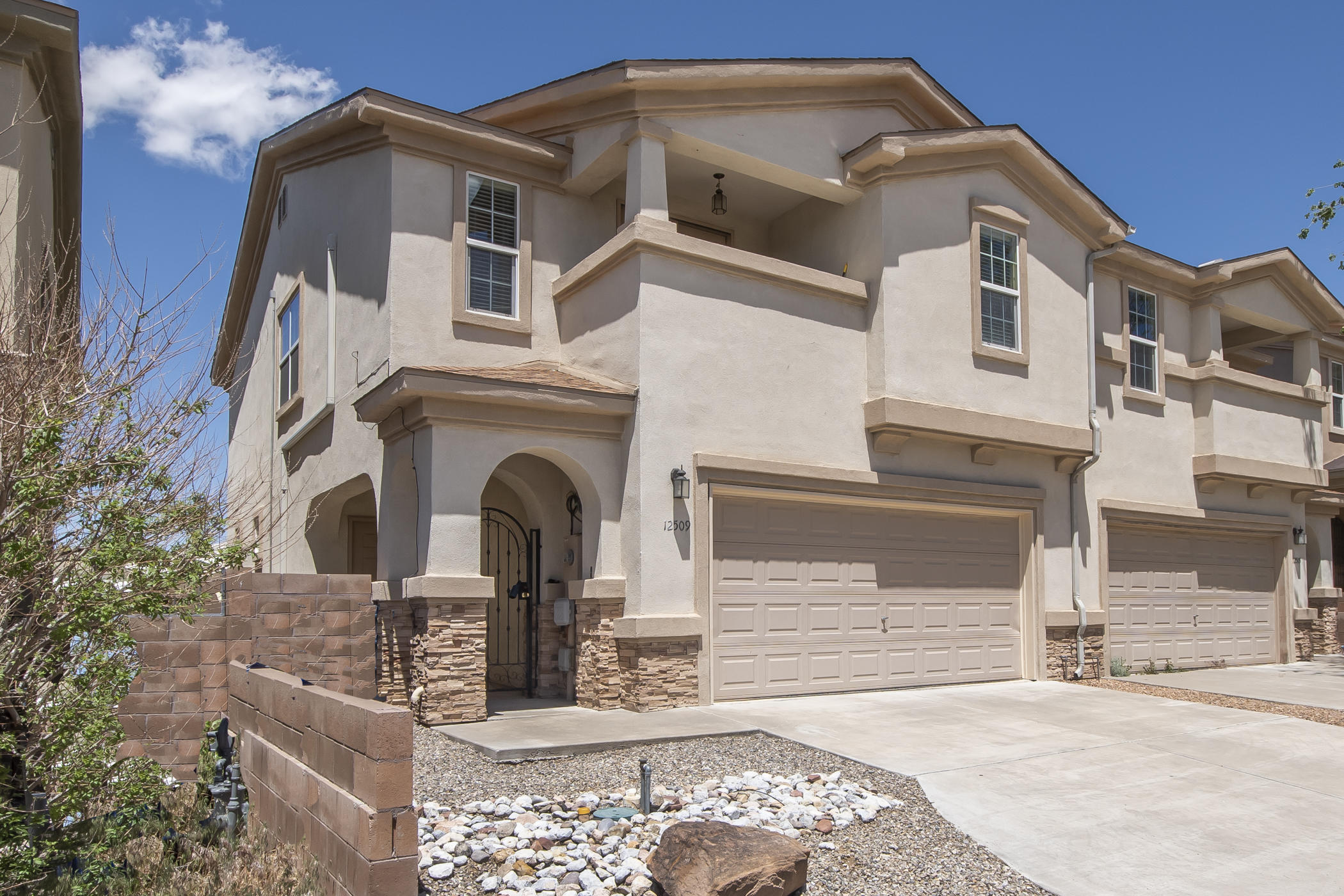 Come see this nicely maintained Beazer townhome, located a couple minute walk to the the Tramway hiking/biking trails.  First level features a great room with fireplace, tile floors, an open eat-in bar, dining area that opens to a private low maintenance backyard. The Kitchen features SS appliances, hard surface countertops,  and is adjacent to the laundry, half bath, and garage access.  Upper level boasts a second living area, three bedrooms and two baths, including the owner's ensuite, which offers a large wet area w/ separate soaking tub/ shower, two sinks, walkin closet, dressing area, and a cozy covered patio with views. NEW ROOF 2020 (approx), New HWH 2018 (approx) This townhome offers a great lifestyle for the $$.