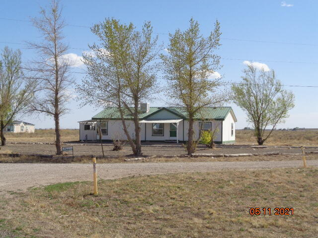 Great home with paved access  with its own well and septic. Sold as is where is. Choice of Estancia or Moriarty school district. newer windows, laminate wood flooring, storage building, all of this for half the price of the city  come on out and enjoy country living at its best .