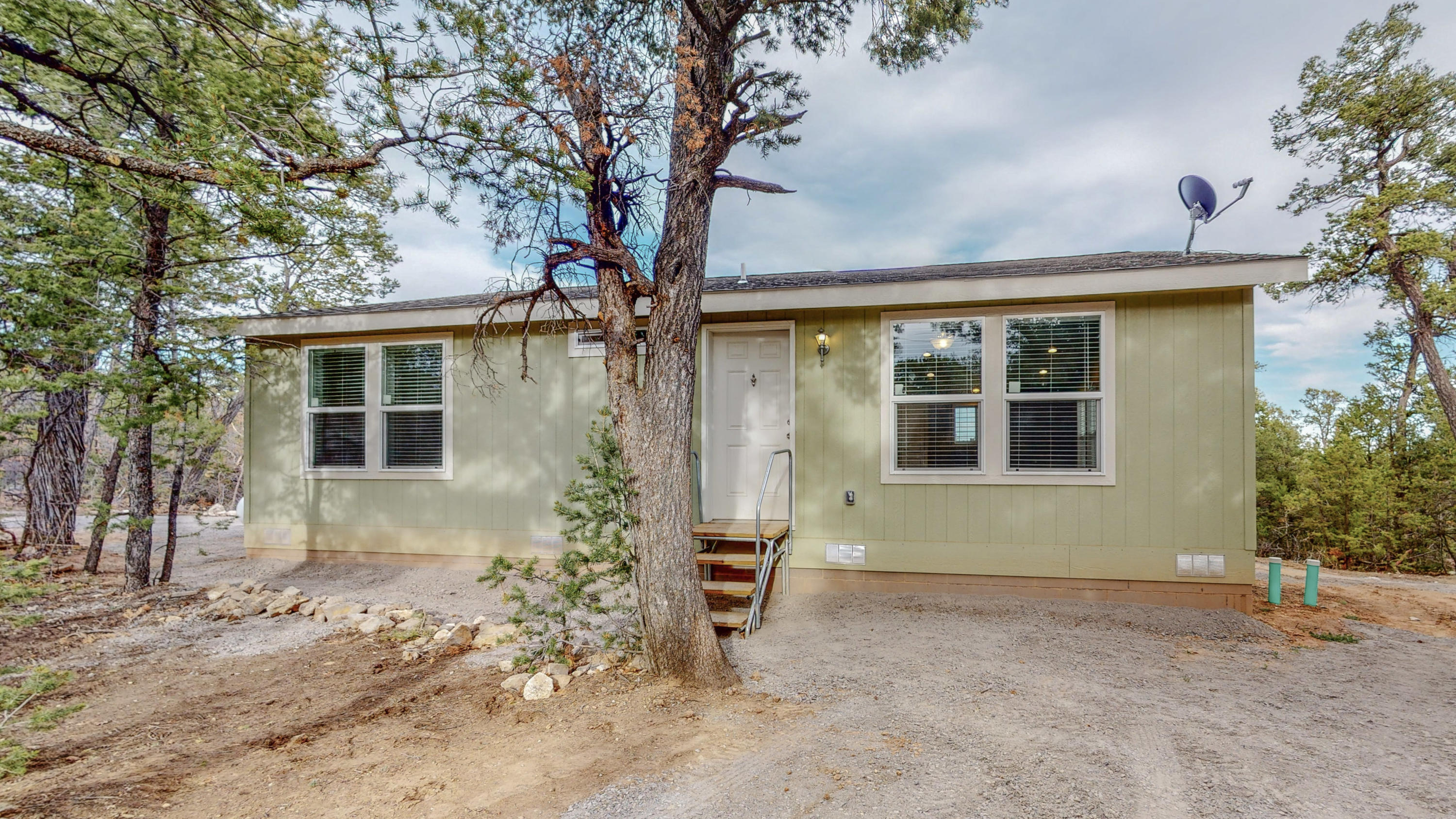 Are you looking for a cozy, nearly brand new 2 bed/ 2 full bath Karsten modular home just steps away from US Forest Serv. access?  This is it!  Built in 2020,  this home features a large open concept dining/living room & kitchen.  Walk in closet in main bdrm and a utility/ W/D area. Second bdrm could also double as an office.  Located on approx.  3/4 acre with expansive views to the east.  Potential exists for a deck to be built on the back, imagine the possibilities!  Could even work as a VRBO type property, due to  proximity to David Canyon (USFS), with it's miles of trails only feet from your front door. Home a water haul (1100 gallon),  pump system/ propane/septic, everything is only a year old! Close to trails, full of possibilities, check out this quiet, peaceful home today!