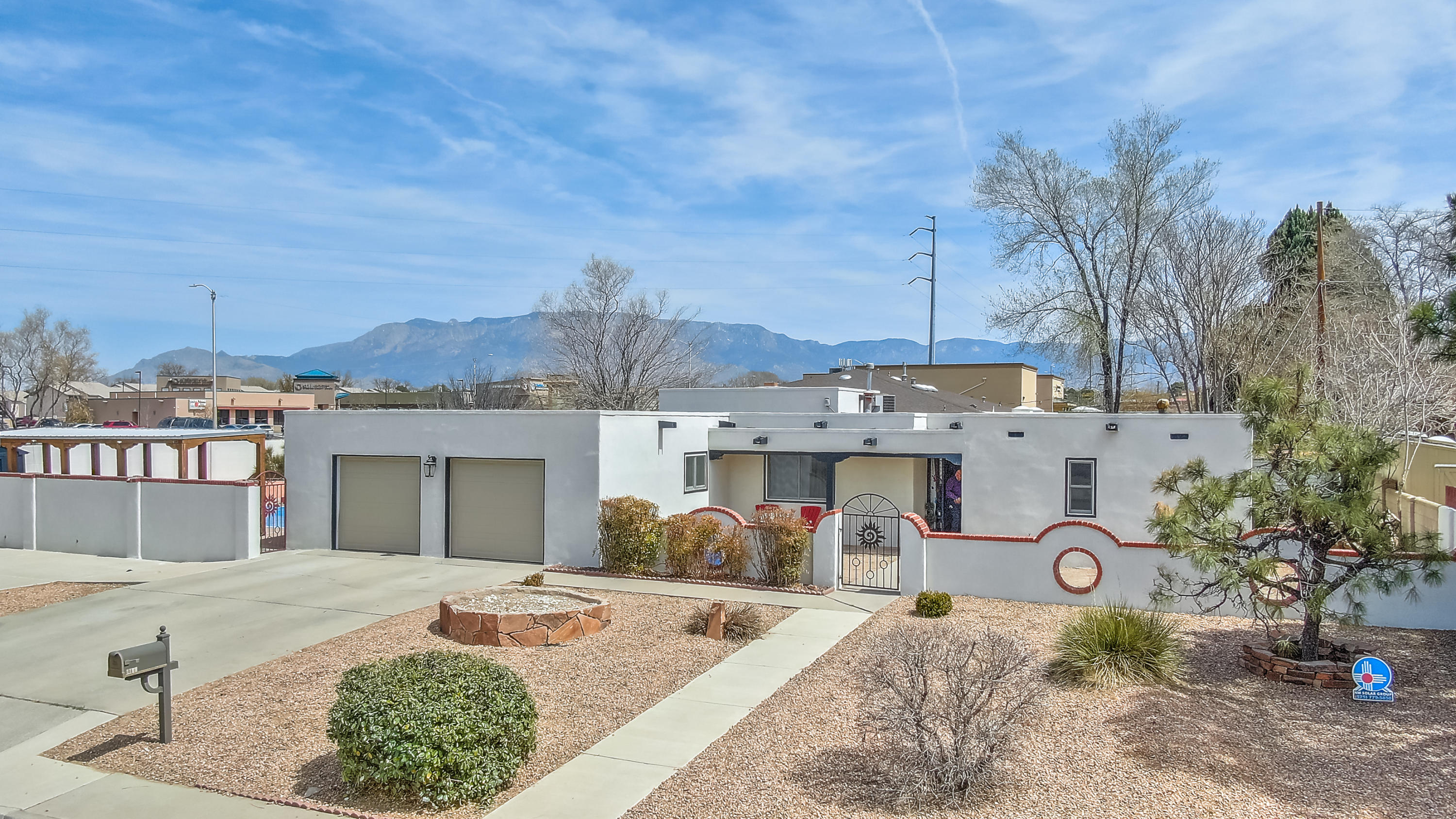 Come see this beautiful Territorial Home centrally located in the city of Albuquerque! This home features many updates including new Pella windows and Stucco. The home is on a 3/4 acre corner lot, with a sparkling swimming pool and outdoor fire pit. The home has refrigerated air with 4 large bedrooms, 3 bathrooms and a 2 car garage! Located near Top Golf. Come see this one before its gone!