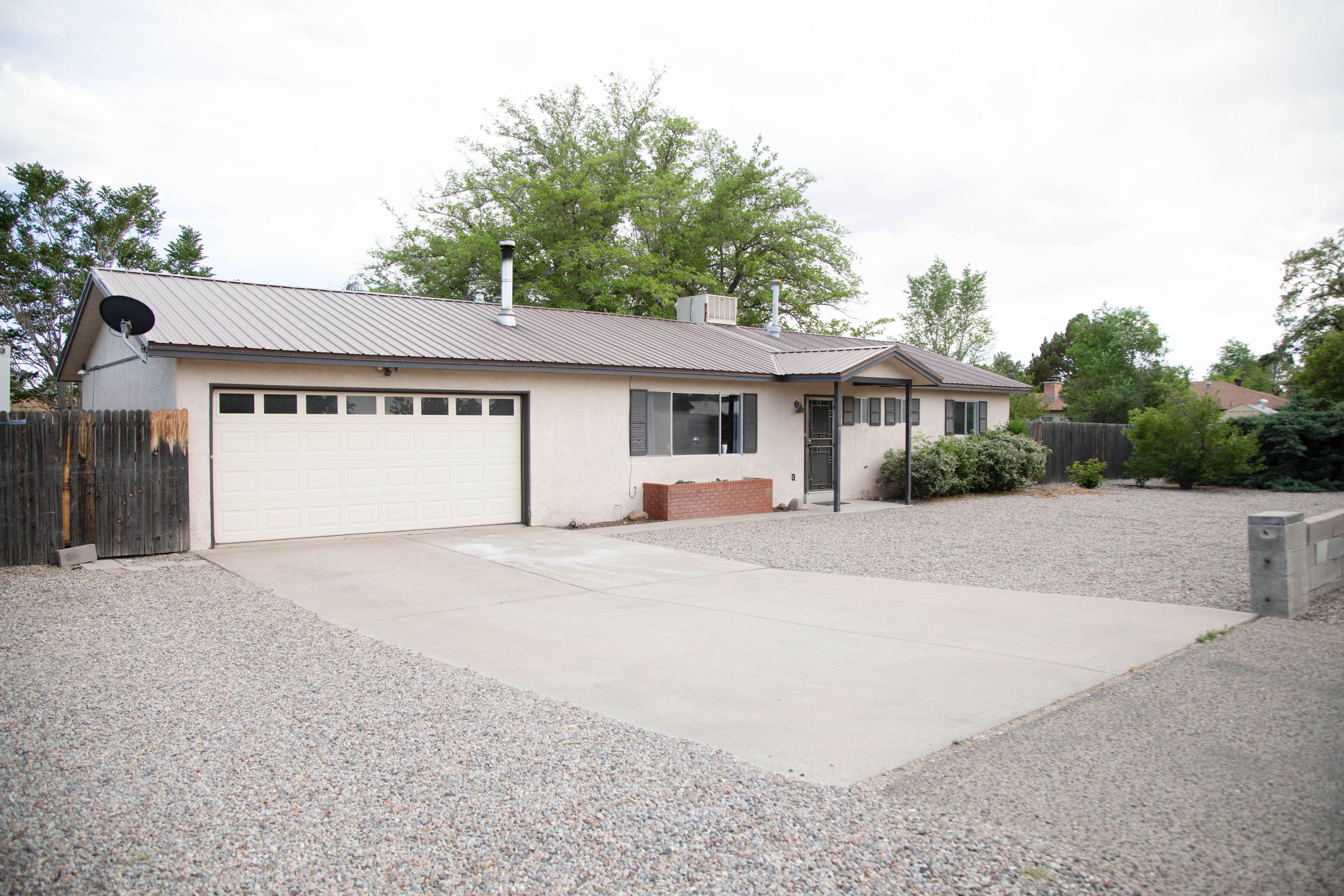 Great home, huge lot, in a great location in the heart of Rio Rancho. Close to Intel,shopping and restaurants. This home sits on a 1/2 acre with tons of possibilities. This home features a spacious living area with a wood burning stove. Open kitchen with granite countertops and breakfast nook with patio doors leading to a huge backyard. Yard is low maintenance with artificial grass and mature landscaping. Two nice sized bedrooms with walk-in closets, Two full baths, one in the master. The garage and laundry room are heated. There is a 12x24 building in the back that is perfect for a home office or home school area. It has electricity and a cooling unit. There is no HOA! Come and see this house before it's gone!