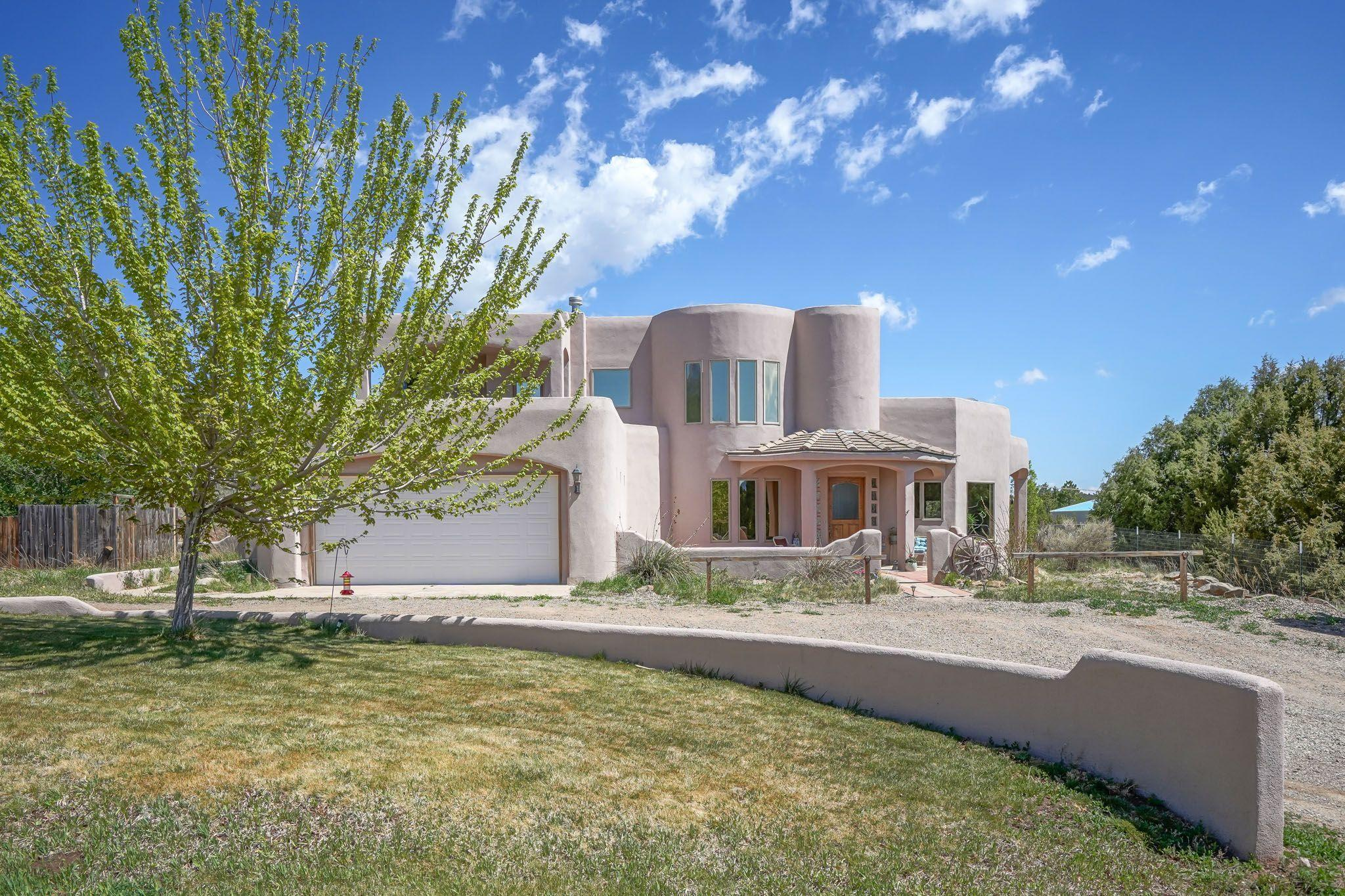 Wonderful Ron Montoya designed home, located in Cedar Crest just 10 minutes outside Albuquerque. Here you will enjoy a serene quiet environment with all the ameneties of a beautiful custom home. Large living area . Two master suites one up, and one down, if working from home the 4th bedroom downstairs can serve as an office. Large kitchen with stainless steel appliances, granite counter tops and kitchen nook with access to a side patio where you can enjoy your morning coffee. All  windows throughout manufactured by Pella. This home sits on 1.3 acres, completely fenced with a backyard area fenced for your favorite pets. Two car garage with plenty of space on the property for your  RV parking.