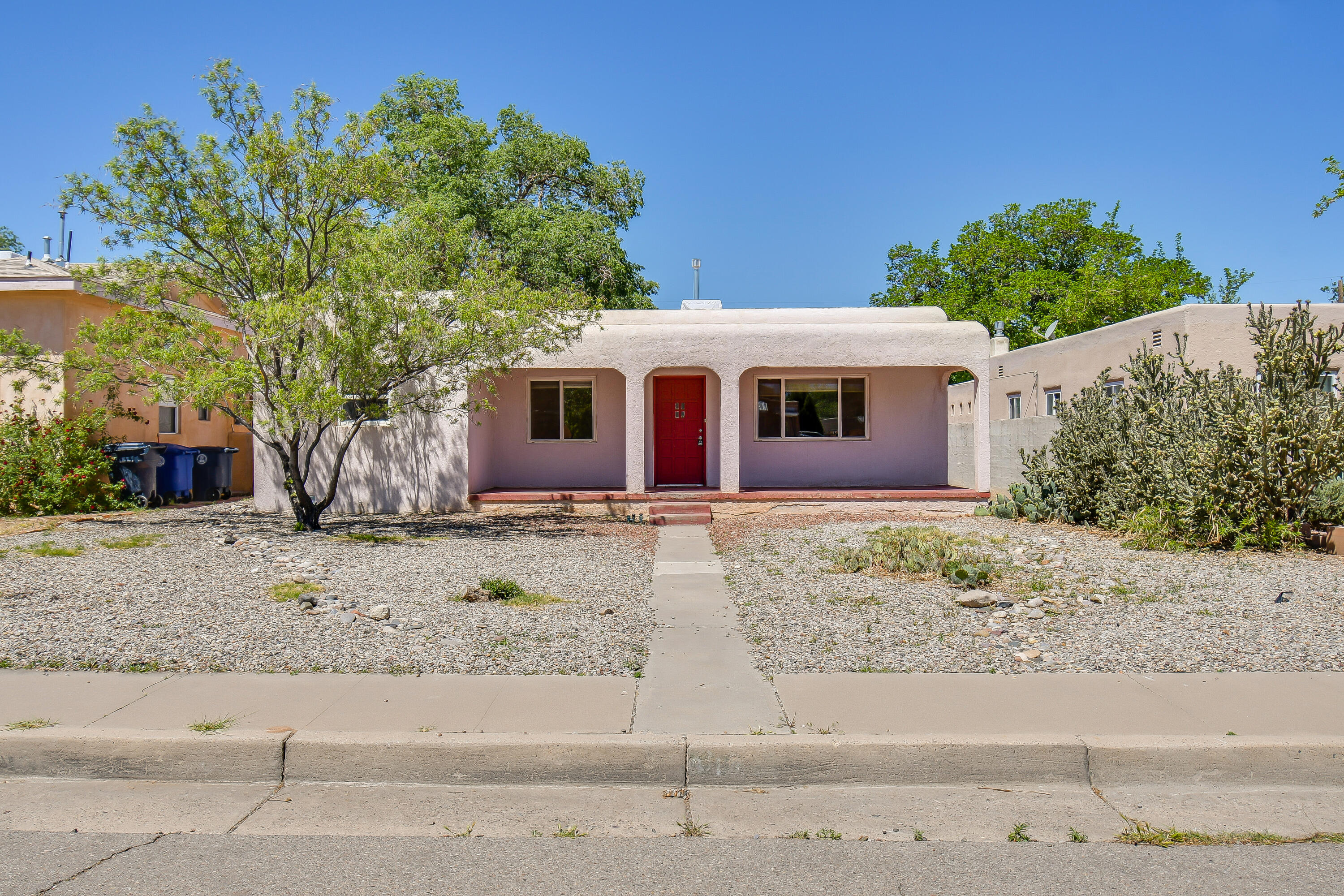 Great opportunity to live in the UNM North area for an affordable price.  This home features hardwood flooring, a nice size kitchen with great storage.  There is a detached garage as well.  Newer HVAC, 2 year old TPO roof over the main house, and a brand new sewer line was installed a few weeks ago.  Come see this terrific home today.