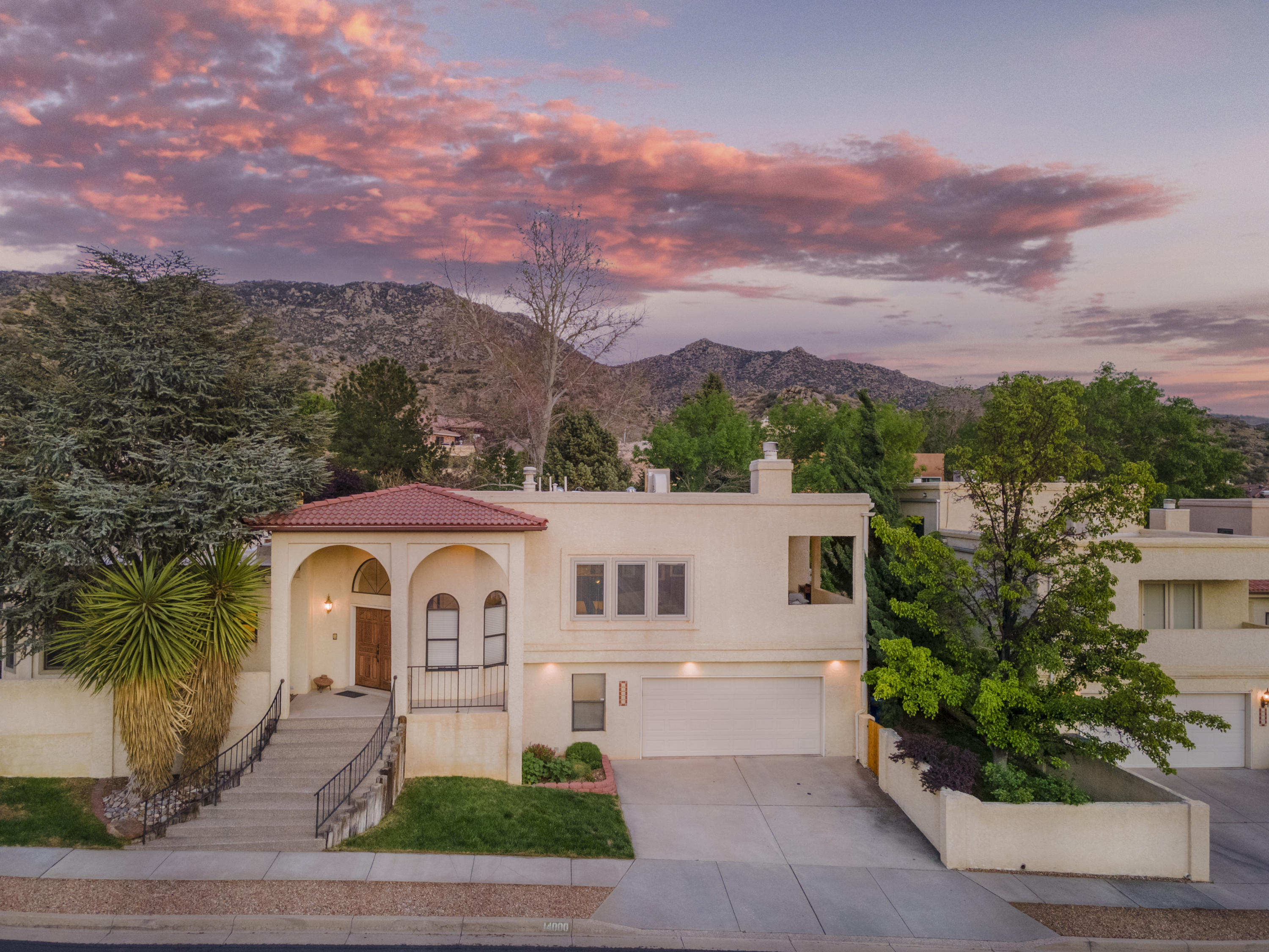 Omega built beauty located in the FOOTHILLS! Situated on a corner lot comprised of 2 lots ( .23 acres) with gorgeous curb appeal. Large welcoming foyer leads to the  first living area, beautiful 1/2 bath, incredible updated kitchen with Ernie Torres cabinets, granite countertops, stainless steel appliances w/dual function micro (also a convection oven), brkfst bar, formal dining w/ access to private covered deck with Stunning Views. The  light & bright den offers a second living area to include a flex space. Large Primary Suite offers it's own access to the backyard. Good sized secondary bdrms. AND as a bonus there is a hobby room/wine cellar. Fabulous entertaining space on the large cedar deck (newer) overlooking the pretty backyard. 2car garage. ABSOLUTELY STUNNING HOME!!