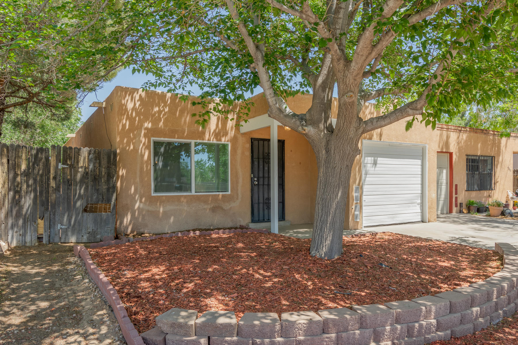 Updated and charming 3 bedroom, 2 bath home. This townhome has been remodeled, and is so cute for a first time home owner, professional, or downsizer. Some improvements include windows with low-e in 2018, TPO roof, Refrigerator in 2017, Stove in 2019, paint, fixtures, remodeled baths, high-efficiency toilets,, flooring, and much more.  The back yard is private and ready to create your very own paradise. Conveniently located in the heart of NW Albuquerque with easy access to I-40, shopping, and schools.